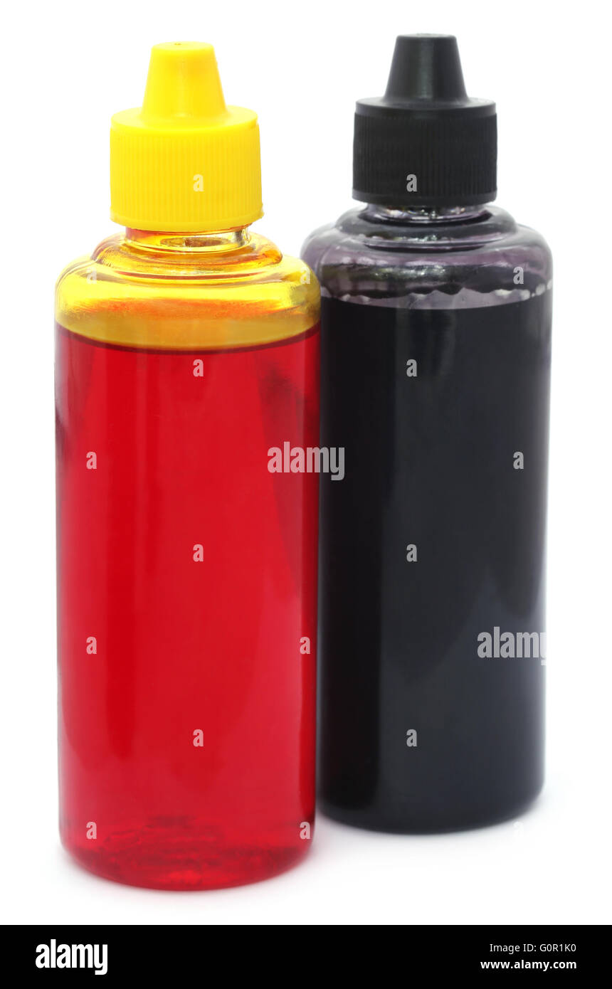 Two printer ink bottles over white background - Stock Image