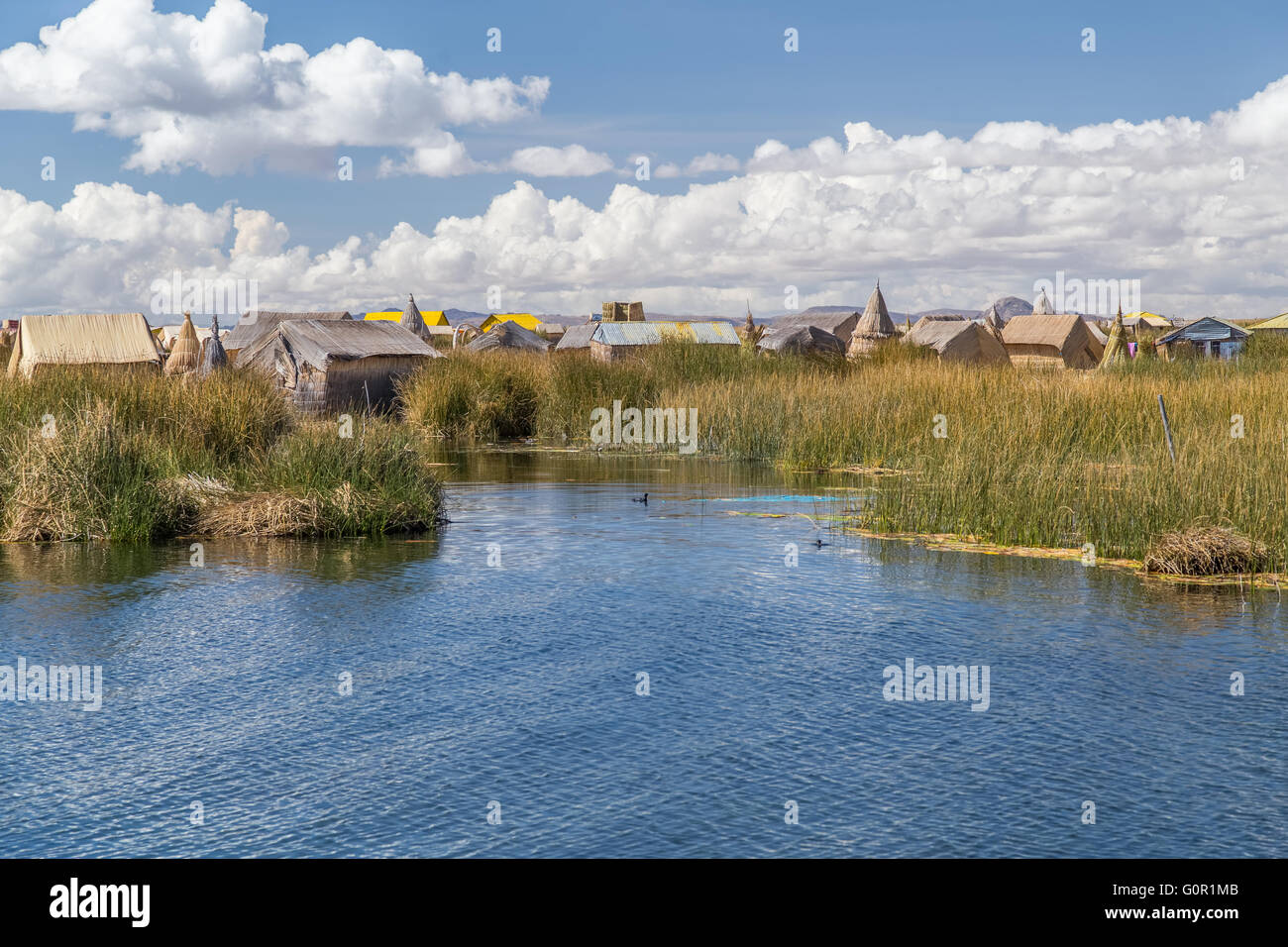 Uros floating island and village on Lake Titicaca near Puno, Peru - Stock Image
