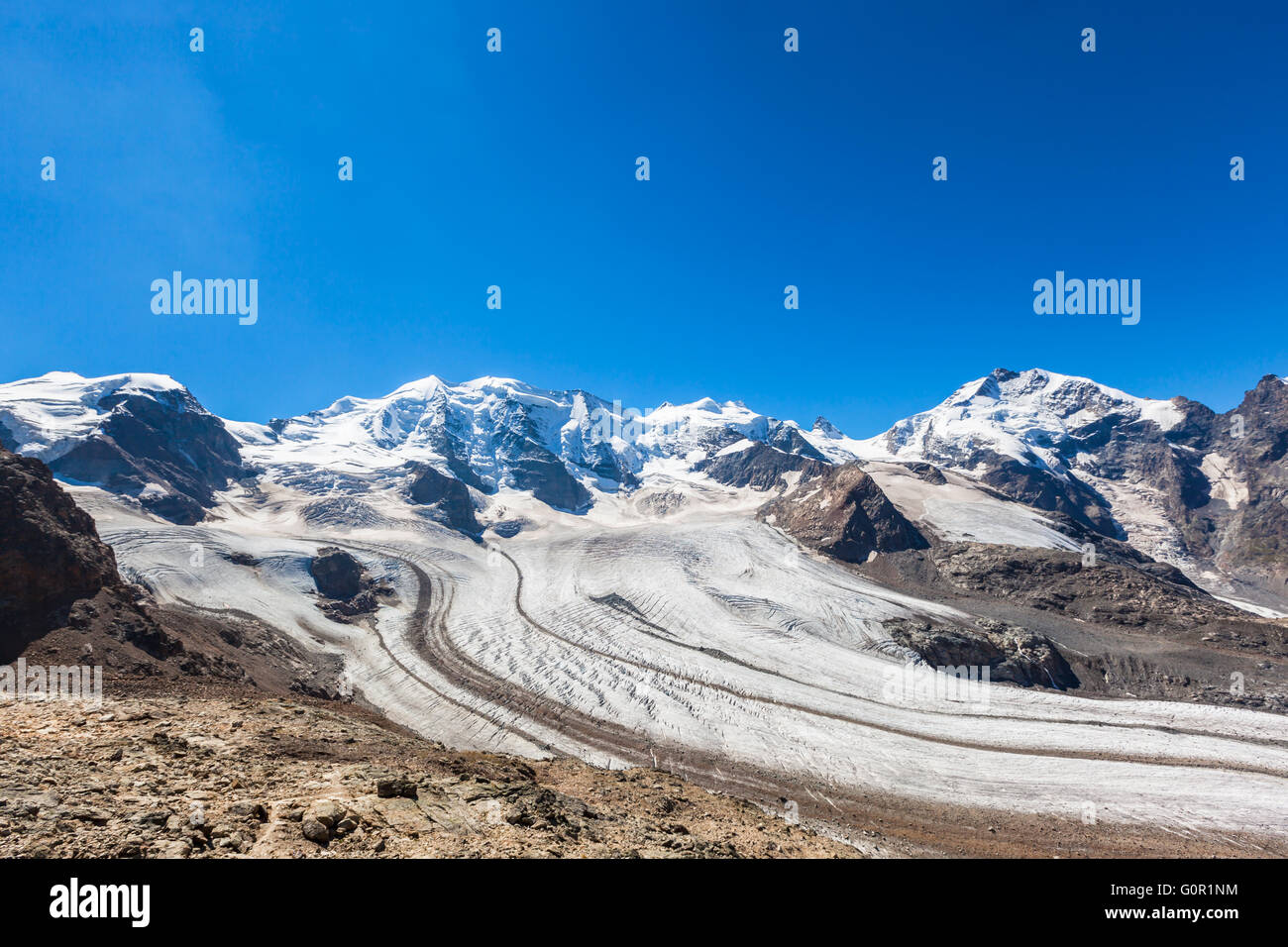 Stunning view of the Bernina massive and Morteratsch glacier at the mountain house of Diavolezza in Engadine area - Stock Image