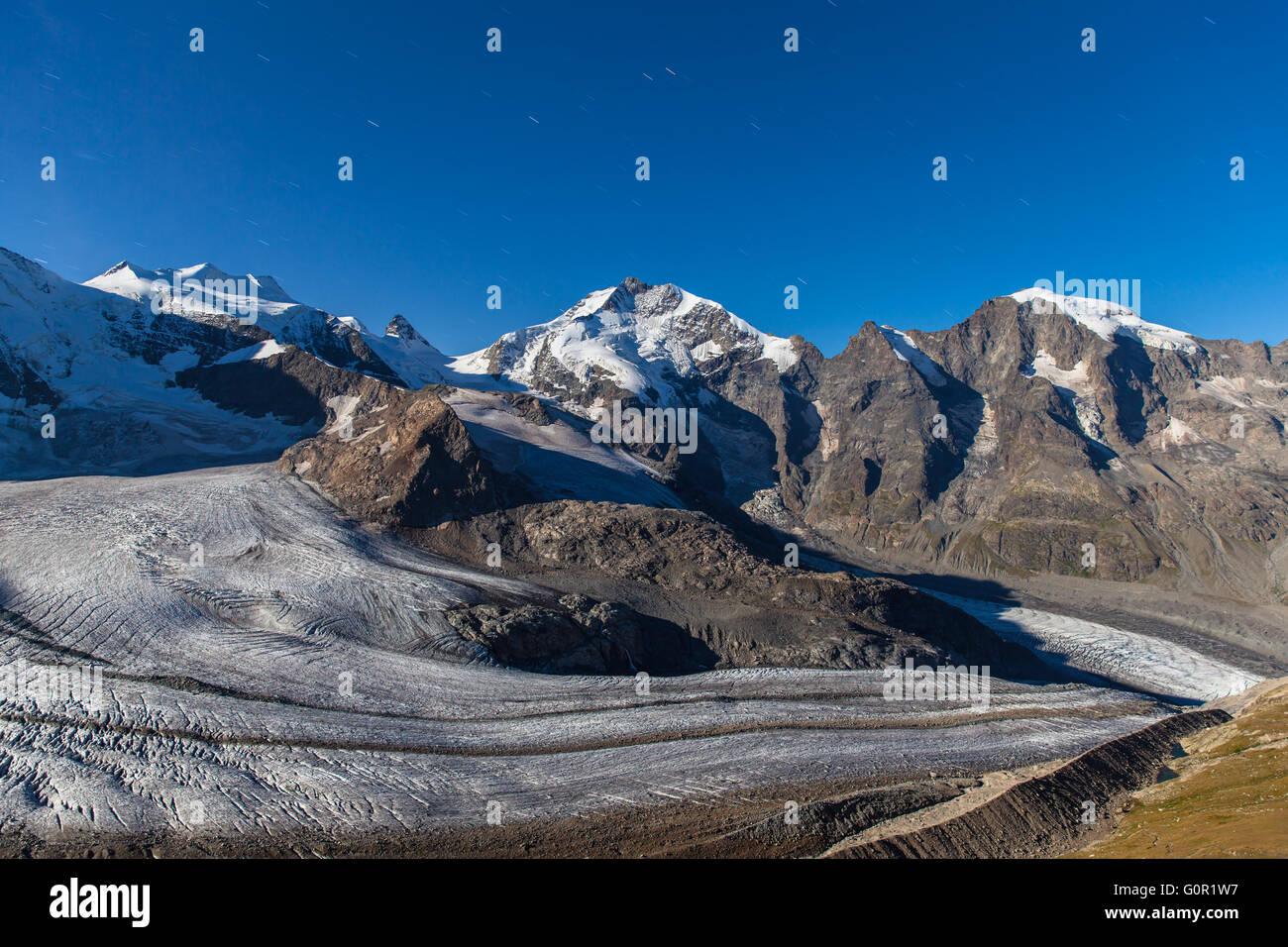 Night view of the Bernina massive and Morteratsch glacier at the mountain house of Diavolezza, in Engadine area - Stock Image