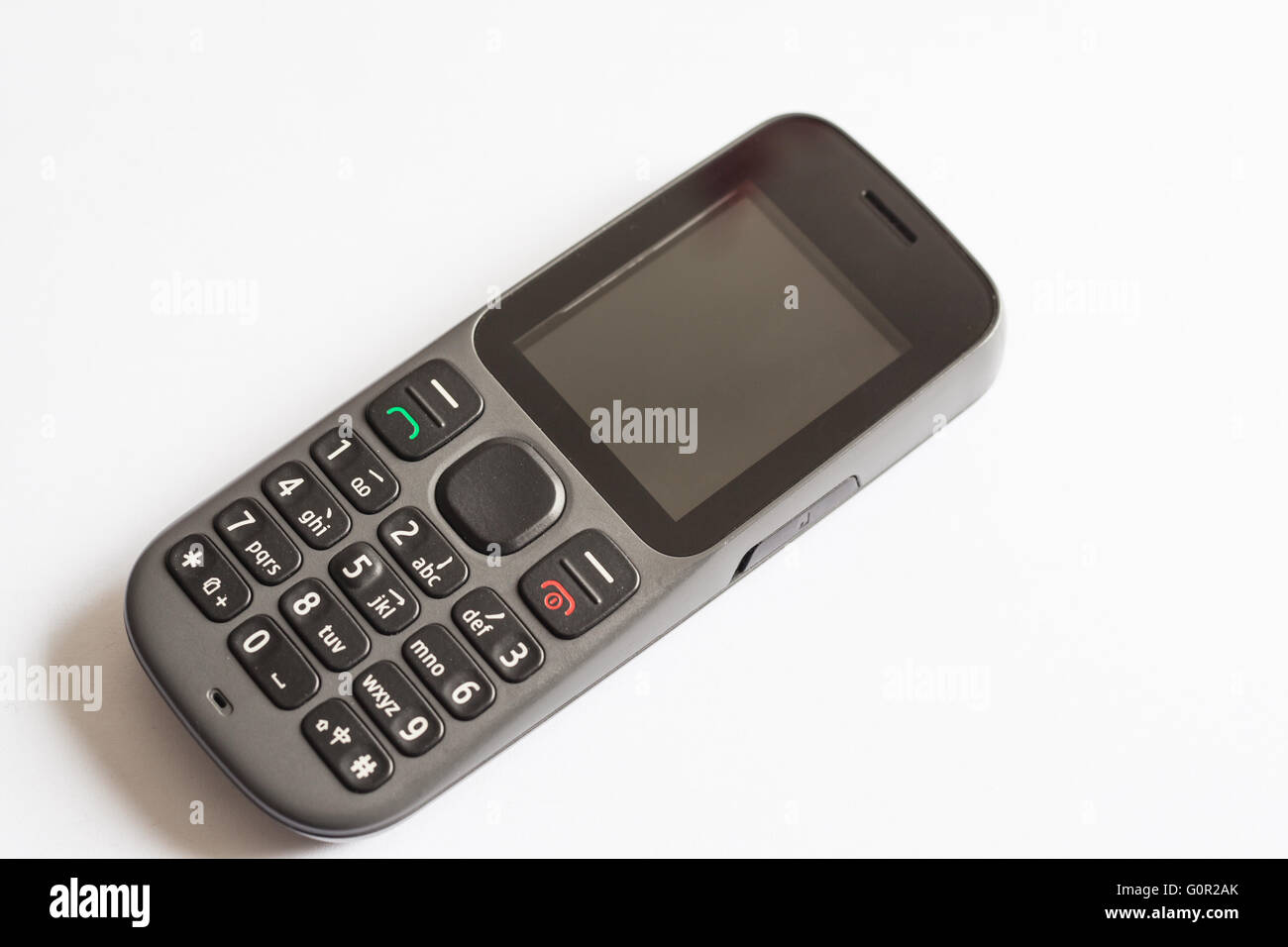 Old Style Cellphone With Chinese Symbols On Keyboard Stock Photo