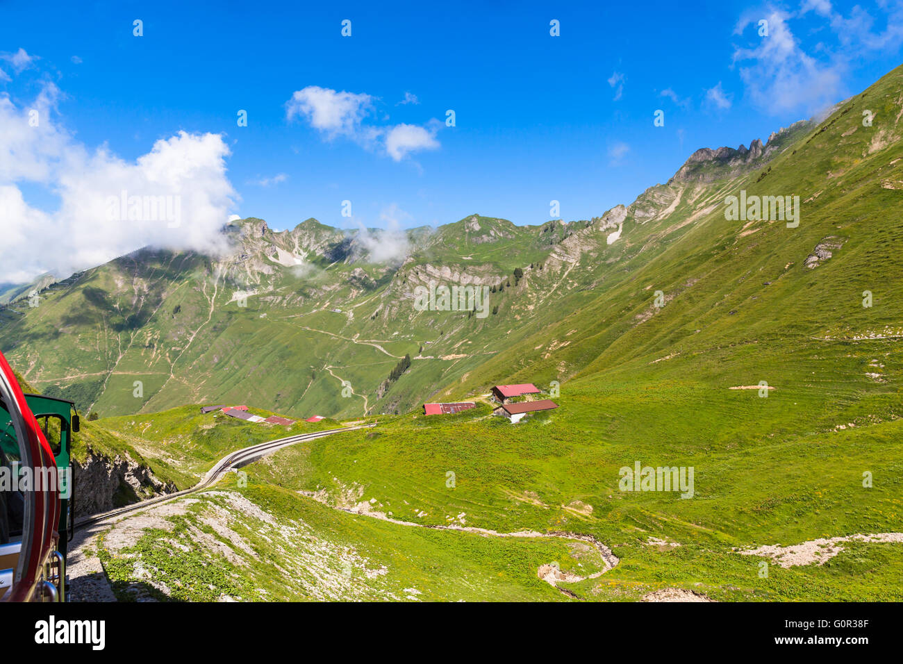 Beautiful view of the alps on the steam train towards the Brienzer Rothorn, on Bernese Oberland, Switzerland. Stock Photo