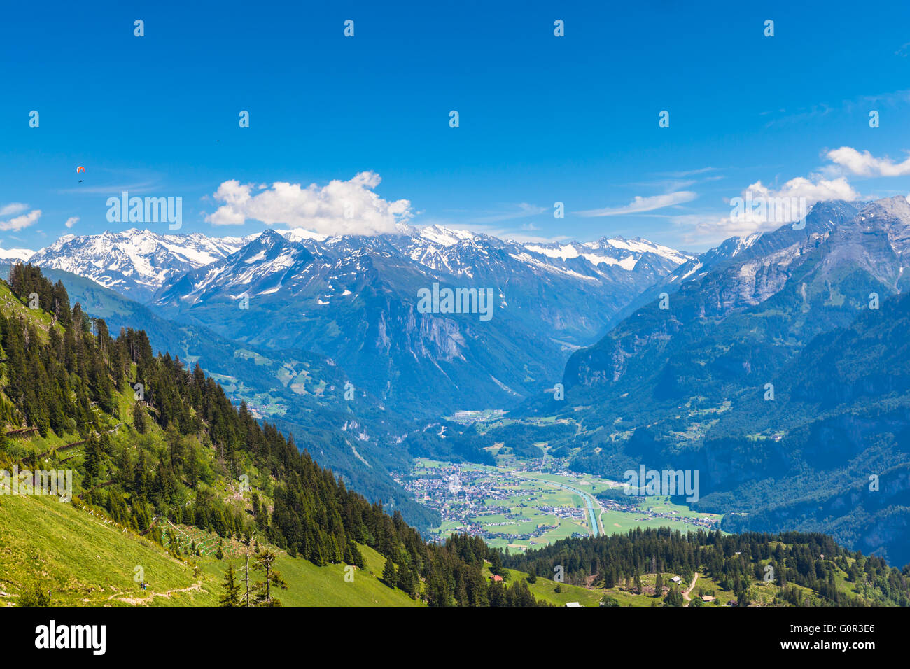 Panorama view on the hiking path on Bernese Oberland with mountain range of the alps, Switzerland. Stock Photo
