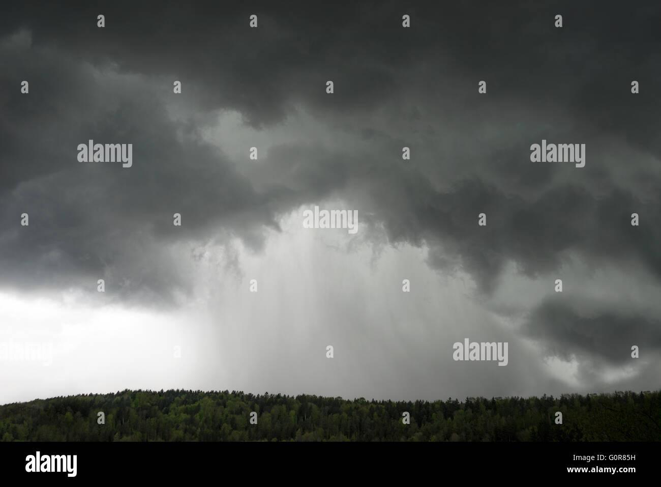 Big dark rain cloud - Stock Image