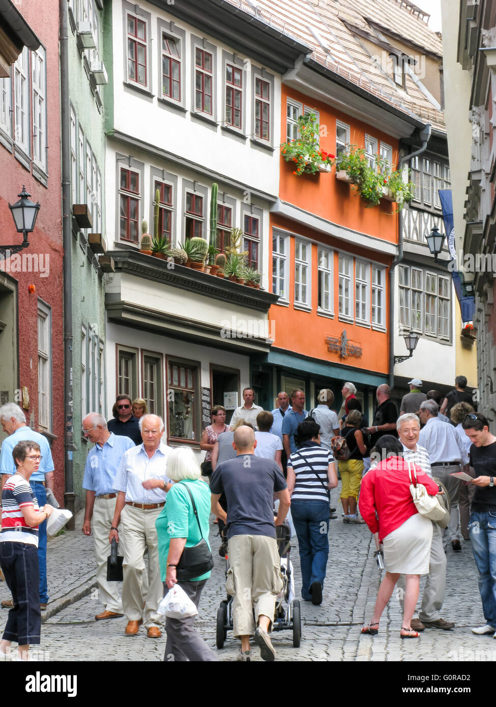 Tourists in shopping street  Kramerstrasse in the city centre of Erfurt, Thuringen, Germany - Stock Image