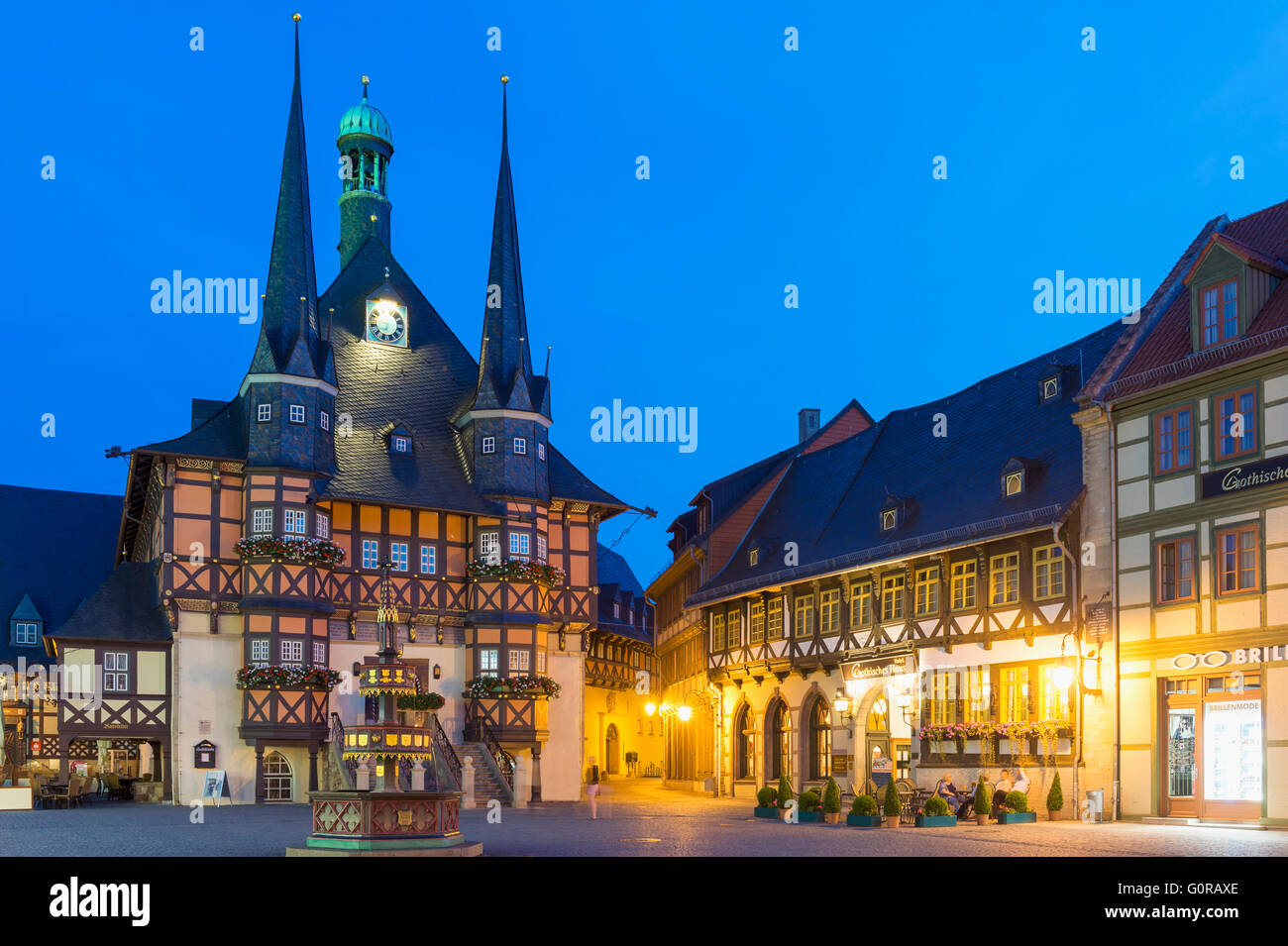 Market square and Town Hall at twilight, Wernigerode, Harz, Saxony-Anhalt, Germany - Stock Image