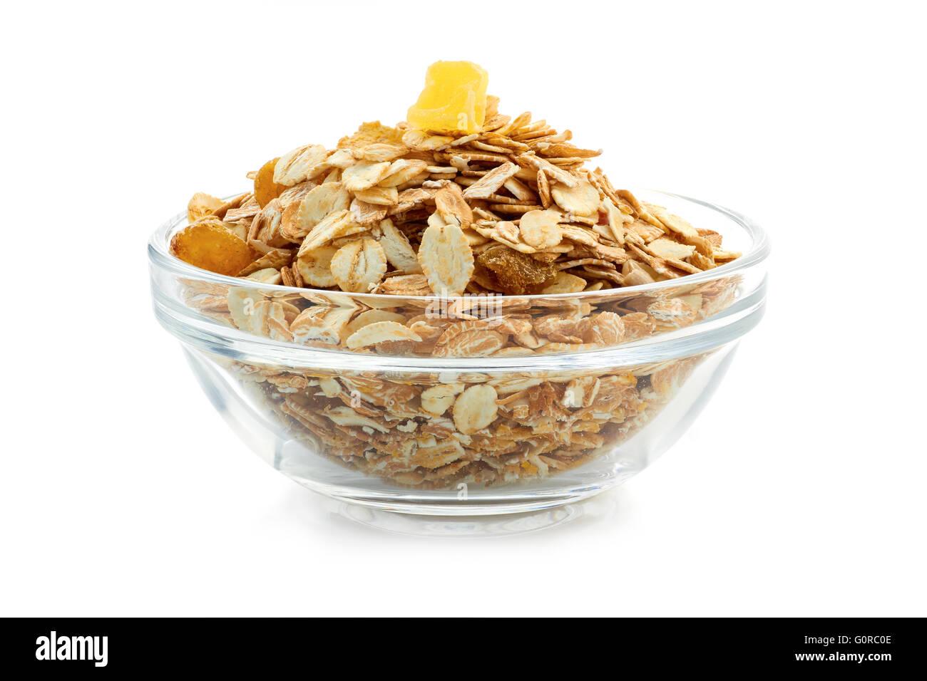 Muesli breakfast in glass bowl on white background Stock Photo