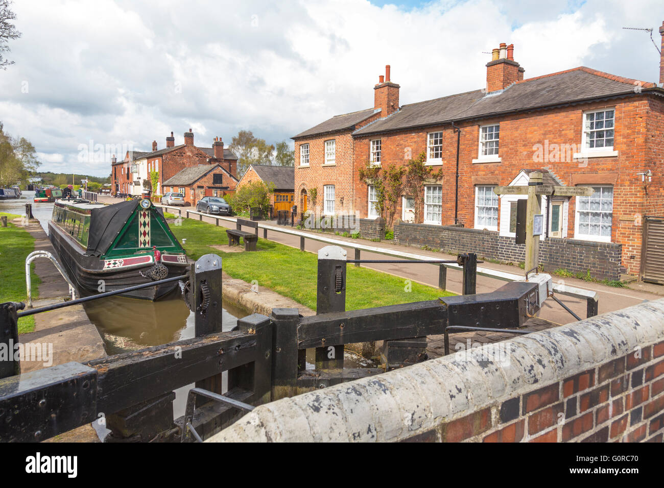 Narrowboats at Fradley Junction lock on the Trent and Mersey Canal, Staffordshire, England, UK - Stock Image