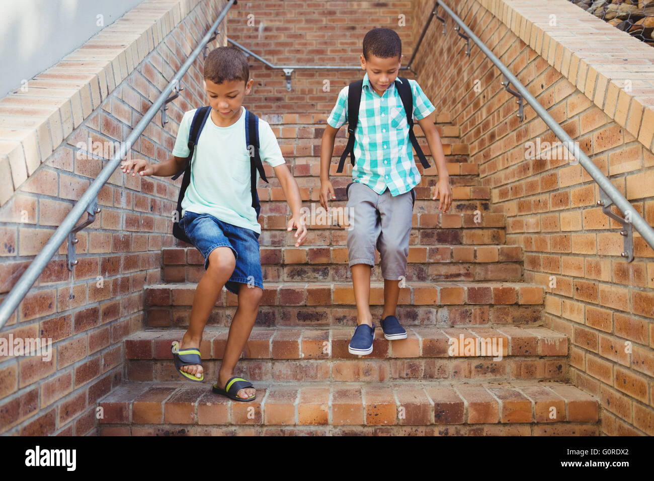 Kids Going Down The Stairs   Stock Image