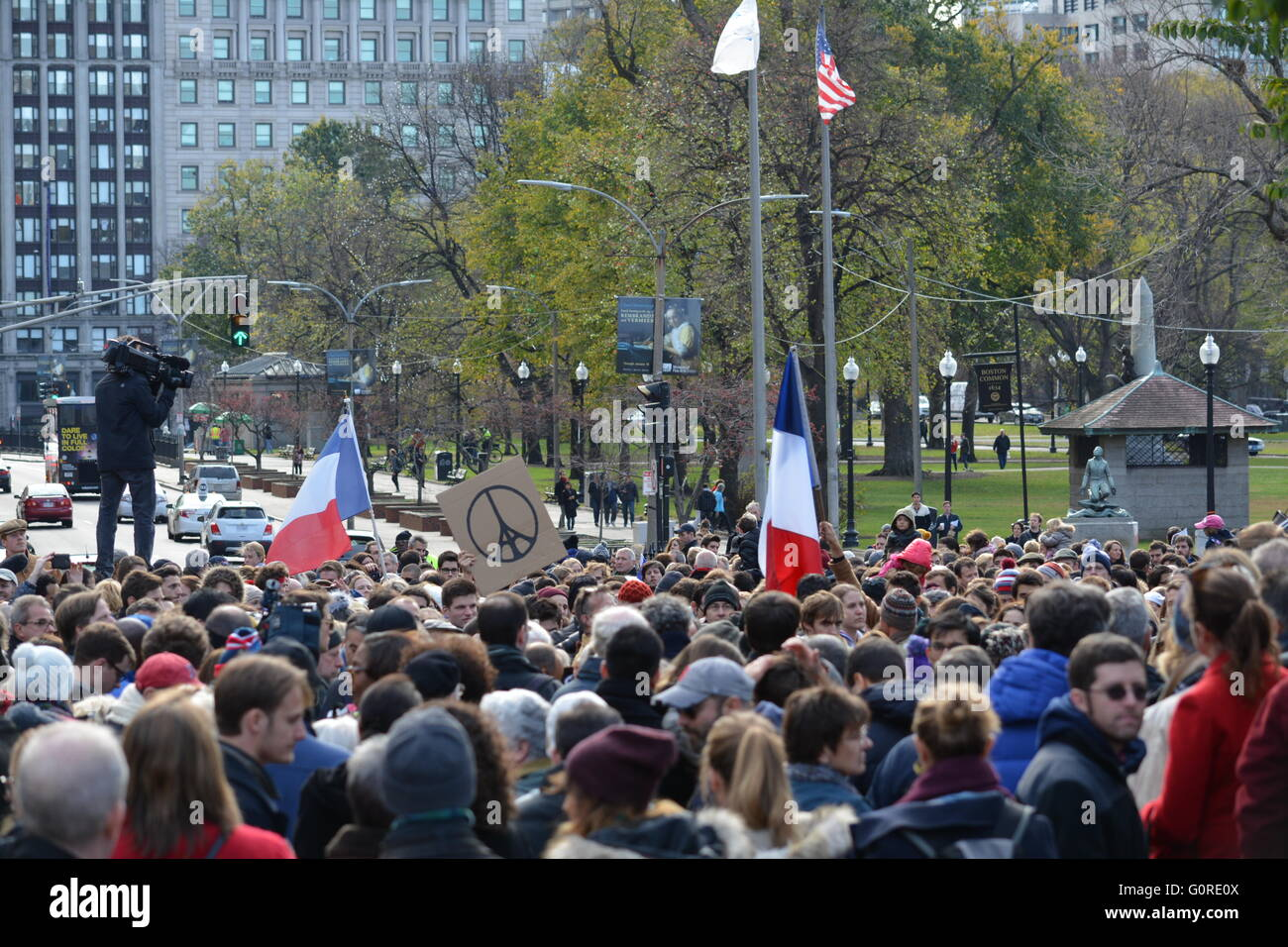 A gathering of people in the Boston Common memorializing the horrible events that transpired in Paris in November - Stock Image