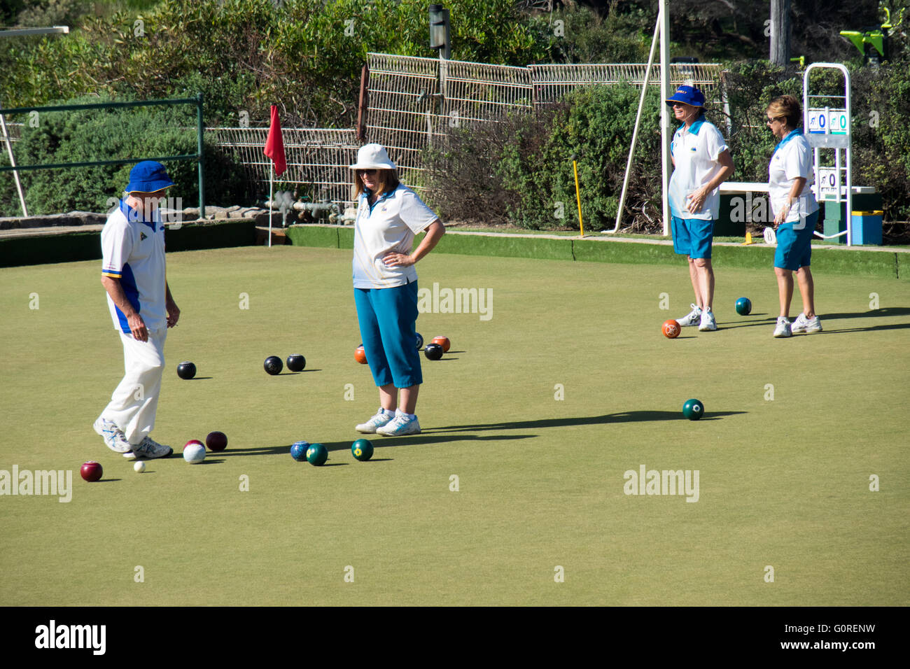 People playing lawn bowls. - Stock Image