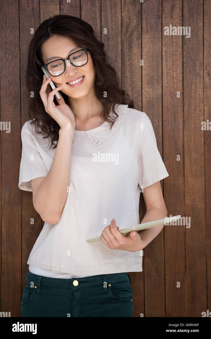 A businesswoman is having a phonecall - Stock Image