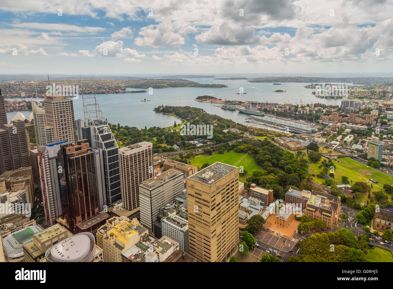 Aerial view of Sydney CBD, Royal Botanic Garden and harbour from Sydney Tower Eye in cloudy weather - Stock Image