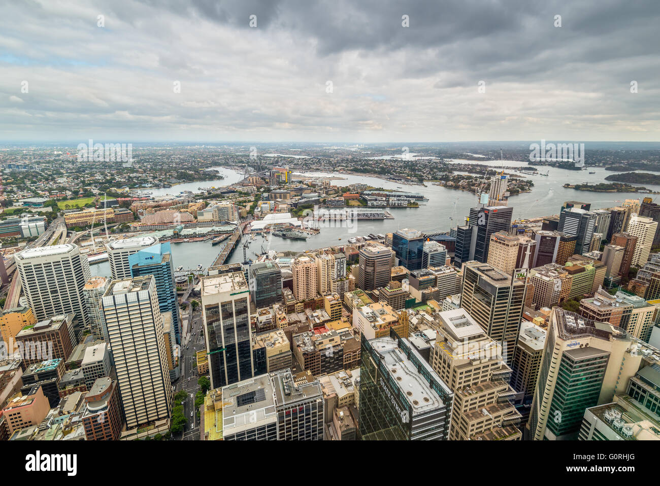 Aerial view of Sydney CBD, Cockle Bay and Barangaroo Reserve from Sydney Tower Eye in cloudy weather - Stock Image