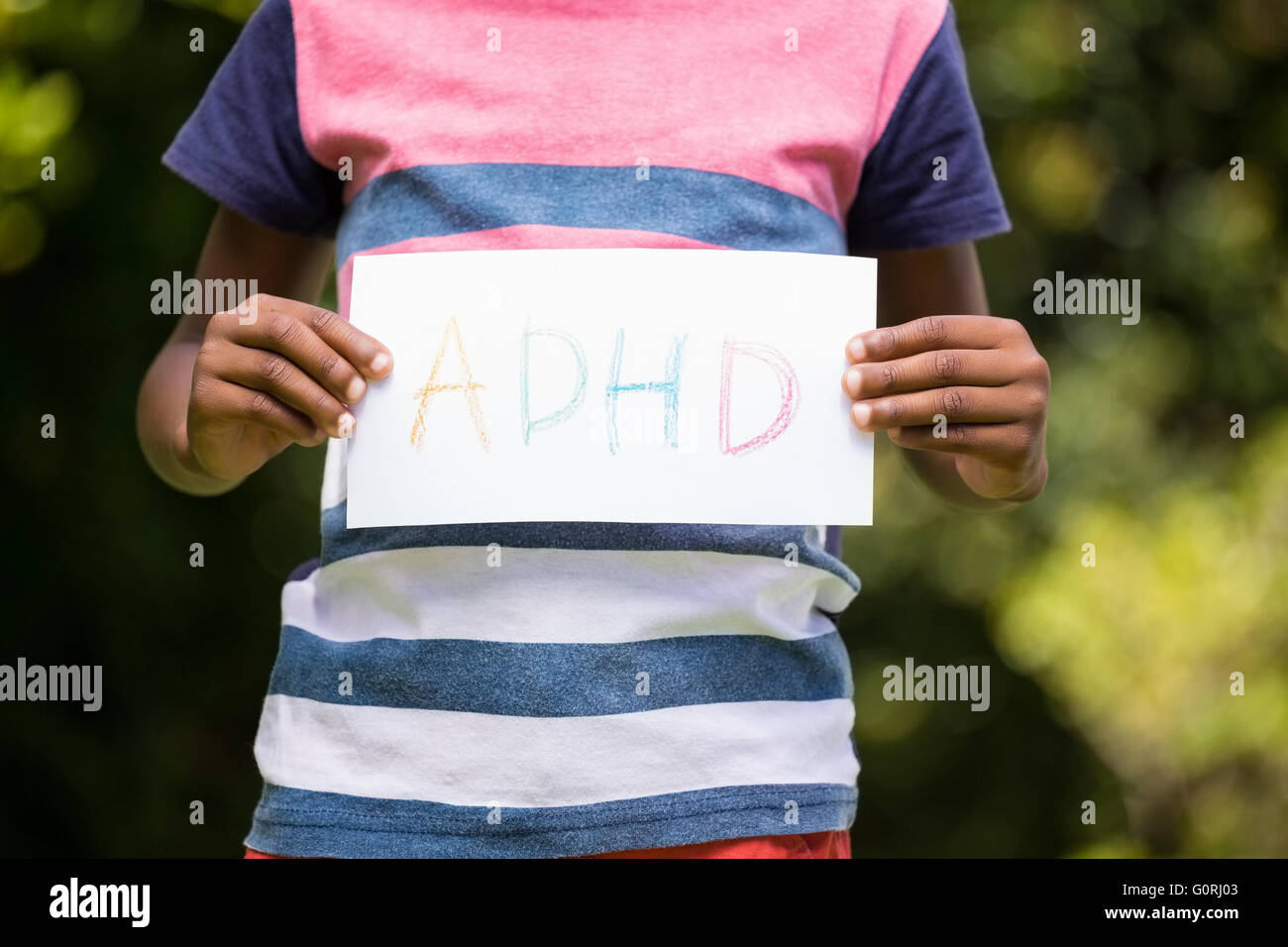 Boy showing a poster with ADHD - Stock Image