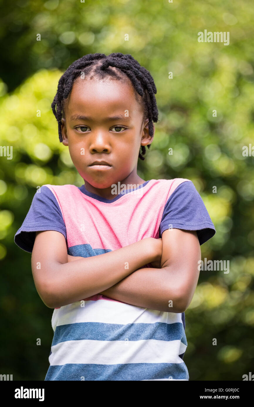 Angry boy with arms crossed - Stock Image