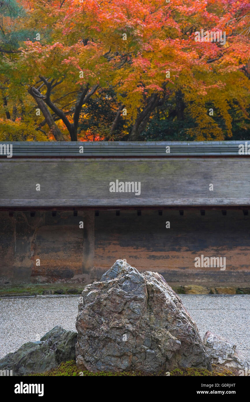 A detailed view shows a stone grouping amidst white gravel in the Zen rock garden at Ryoan-ji, a Zen Buddhist temple - Stock Image