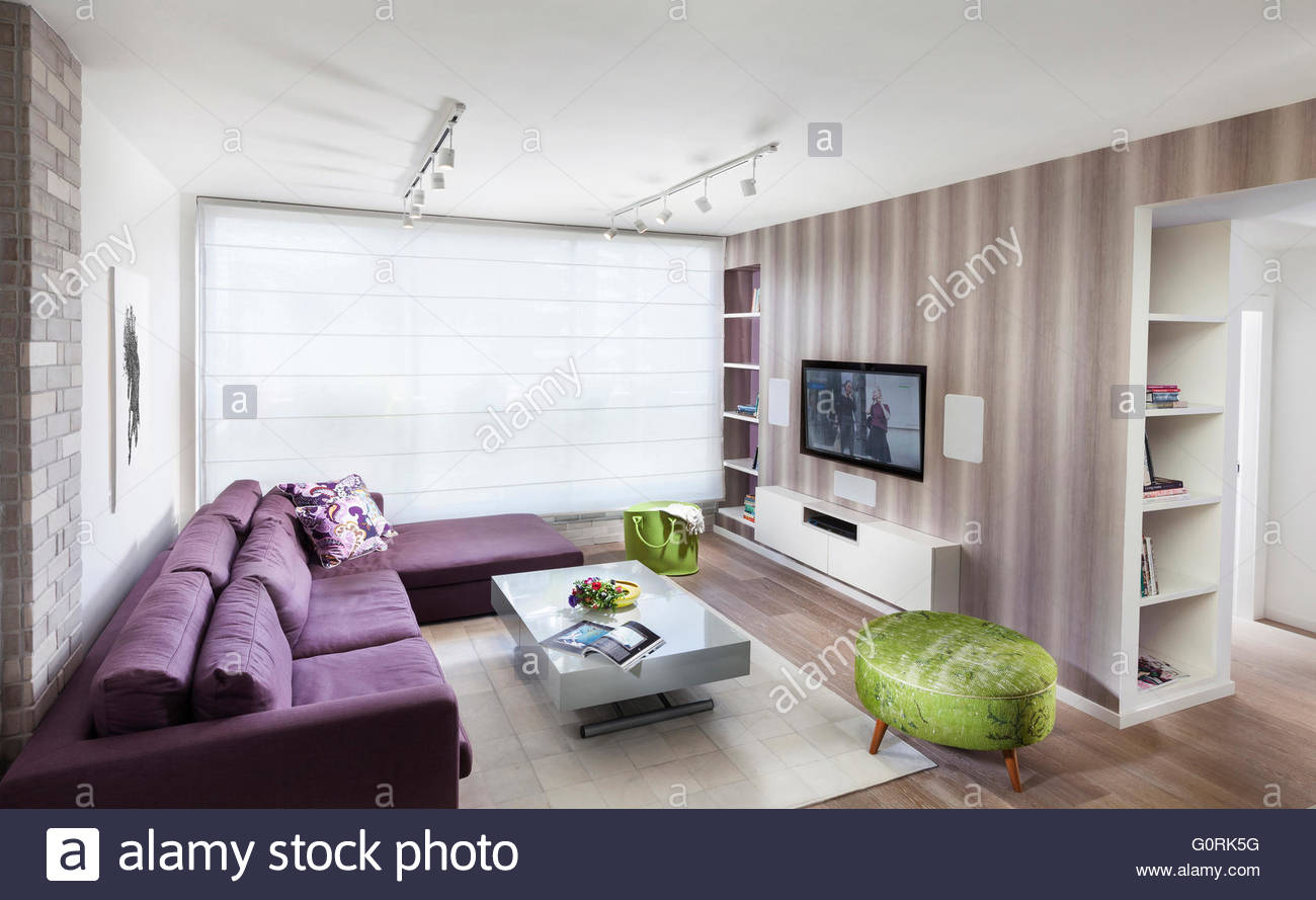Tel Aviv apartment. Open plan living room with modern furniture and ...