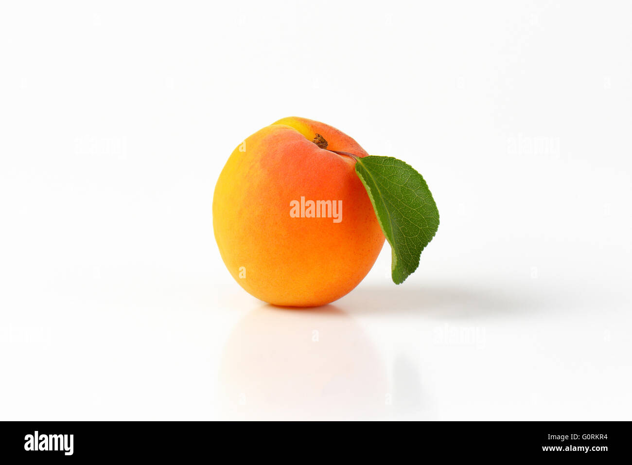 Fresh apricot on white background - Stock Image