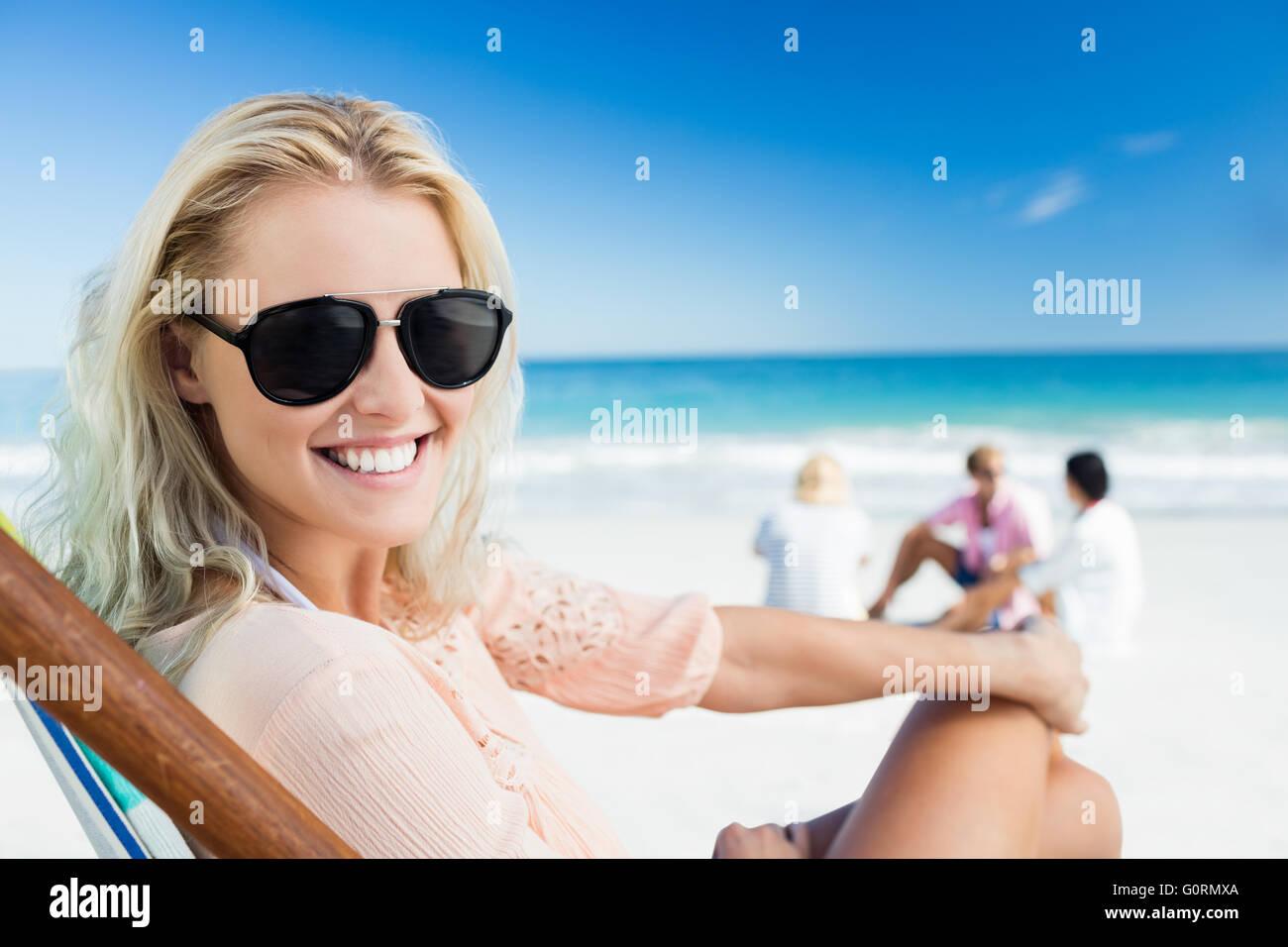 Woman lying on the beach - Stock Image