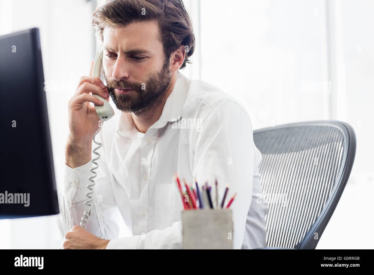 A man having a phone call - Stock Image