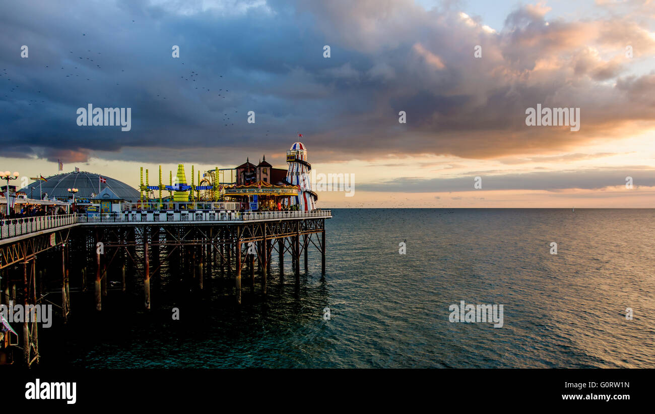 Evening on Brighton pier, East Sussex, England - Stock Image