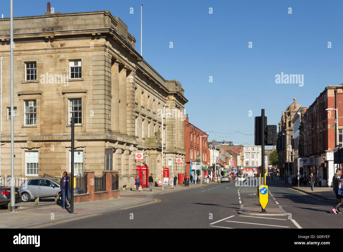 Deansgate, Bolton, looking east with the central post office building left foreground. - Stock Image