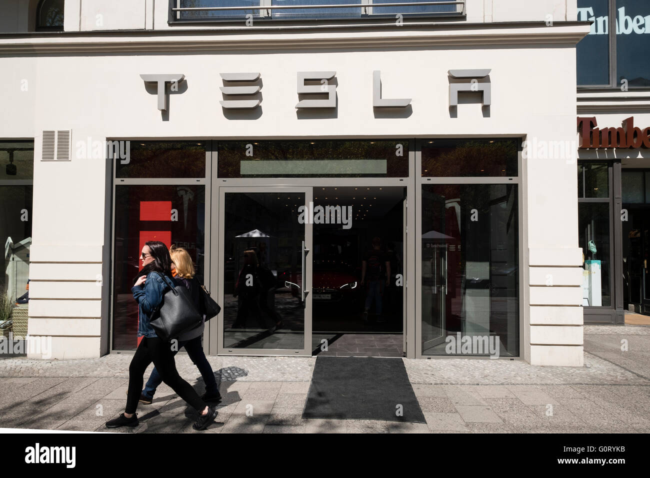 Exterior of Tesla electric car showroom on Kurfurstendamm, Kudamm, in Charlottenburg, Berlin, Germany - Stock Image