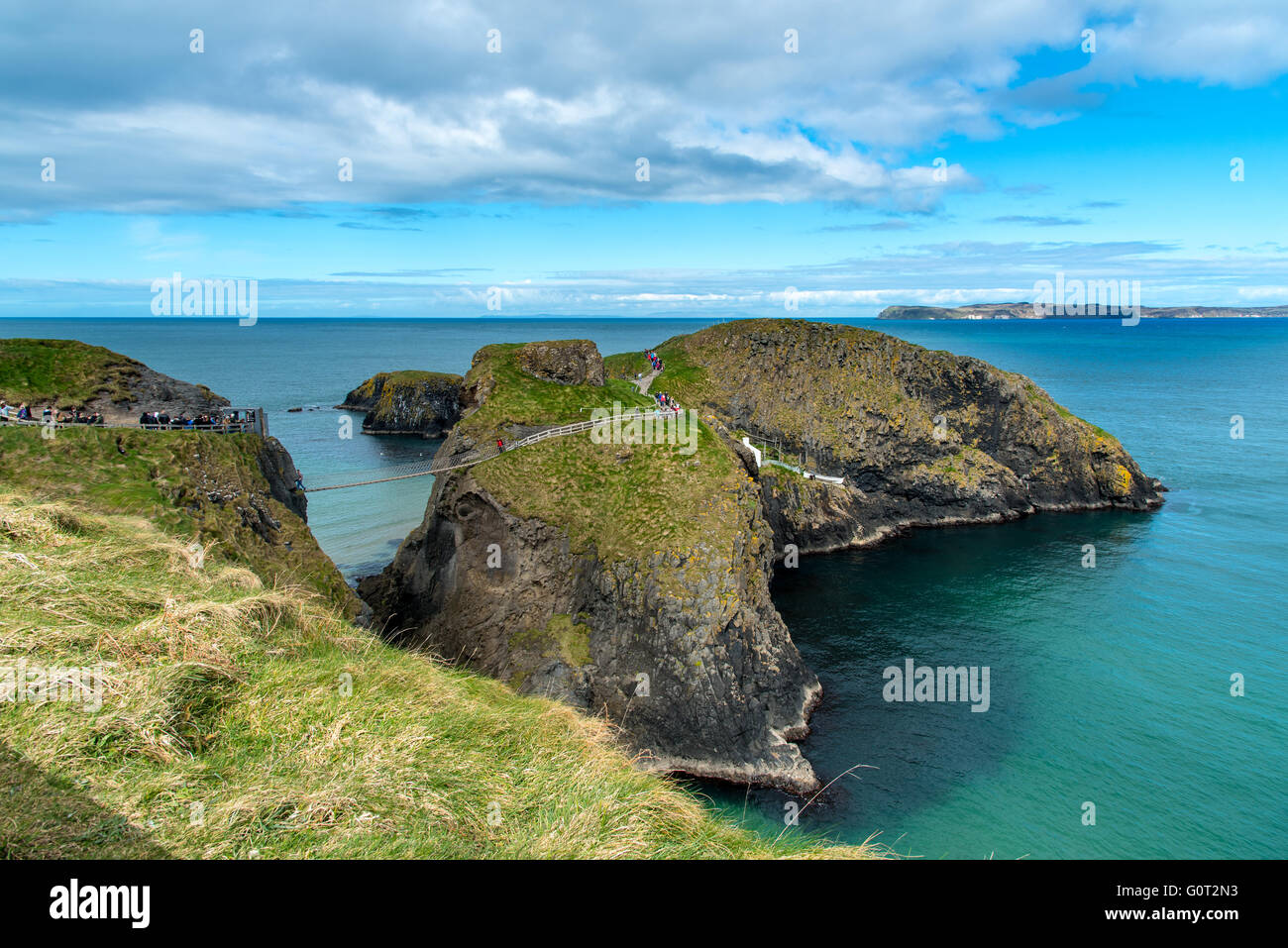 COUNTY ANTRIM, NORTHERN IRELAND - 5 APR 2016: Carrick-a-Rede, with Rathlin Island in the distance. - Stock Image