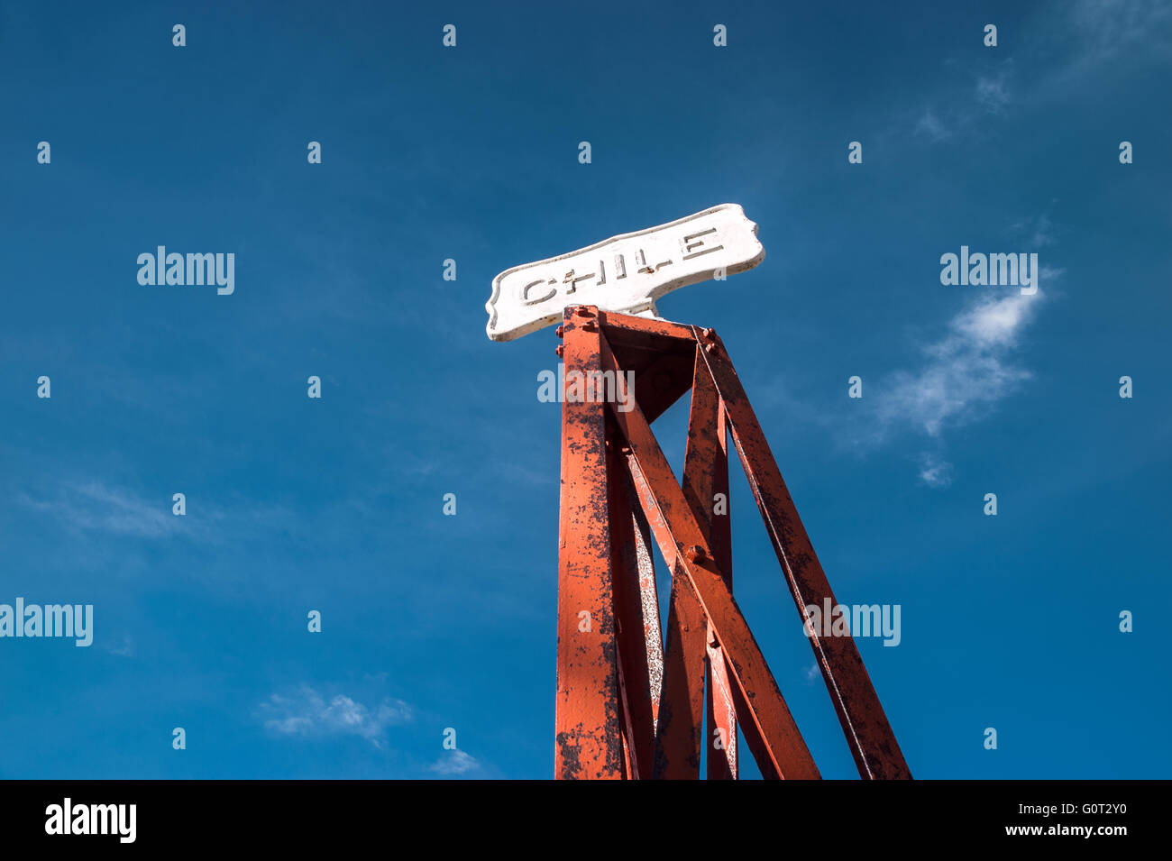 Vintage border post, Road sign at the Patagonia border of Argentina and Chile in Paso Cardenal Samore. Chile - Stock Image