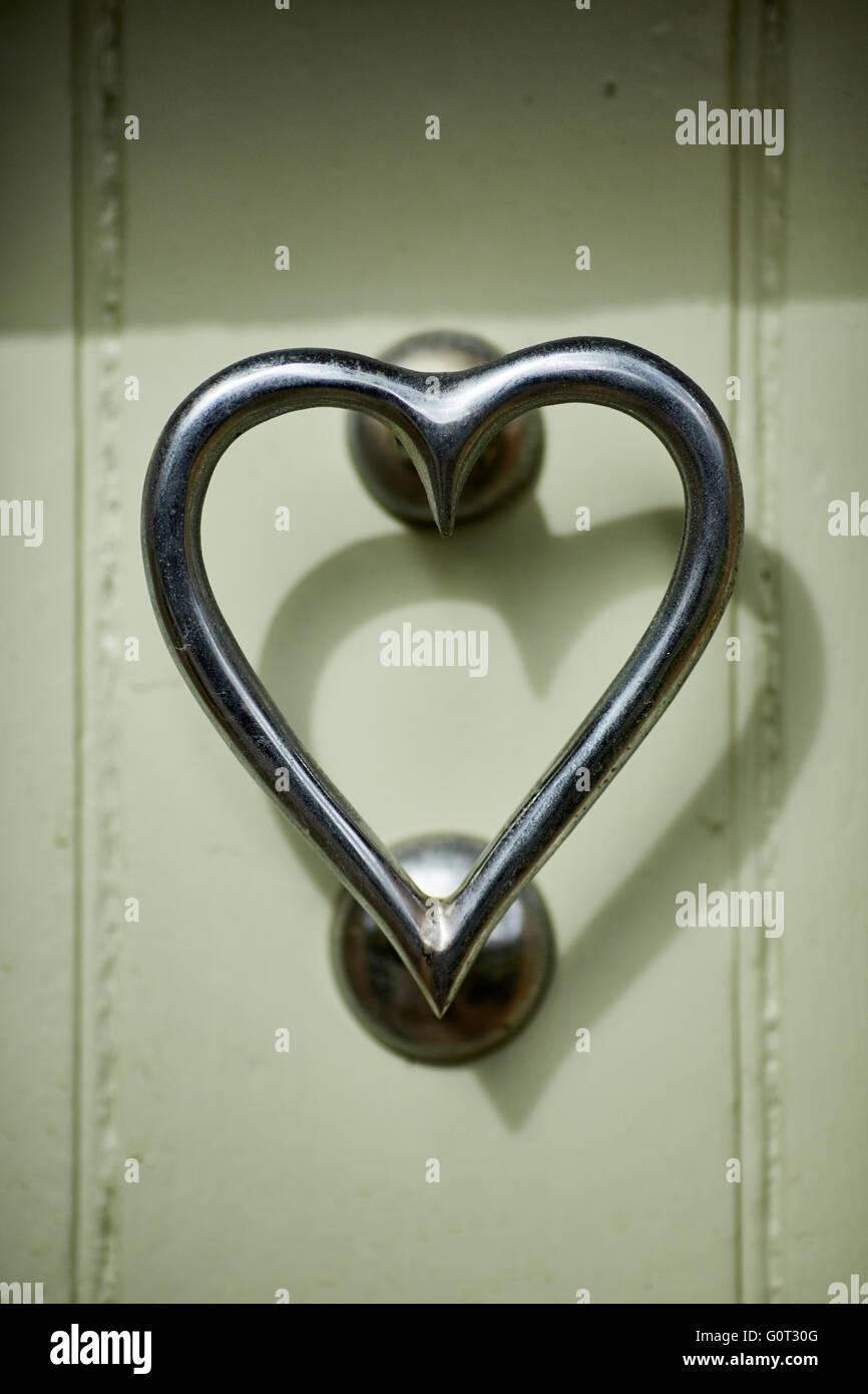 Love heart shaped door knocker & Love heart shaped door knocker Stock Photo: 103791424 - Alamy