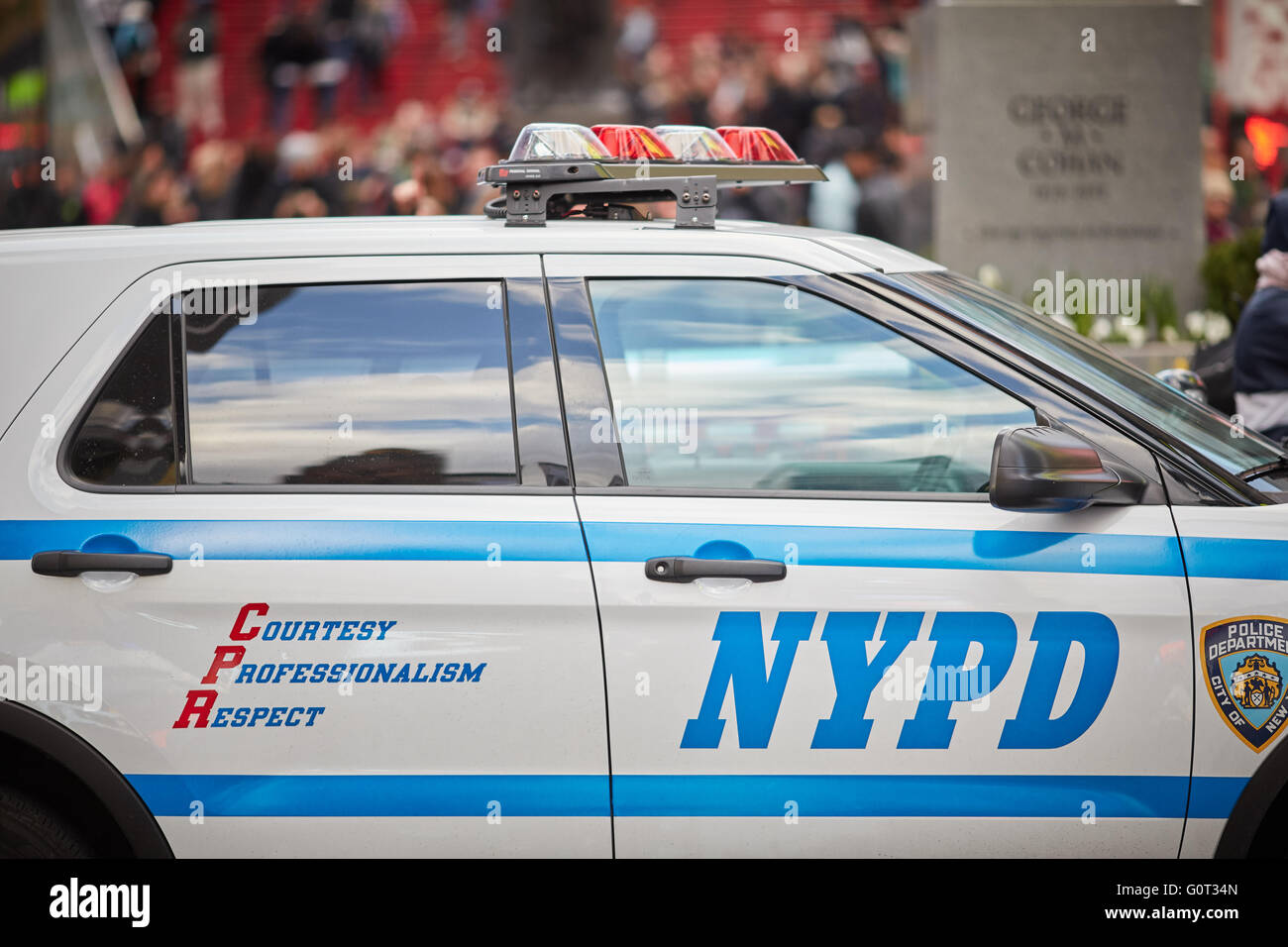 New York times Square broadway  NYPD courteous Professionalism Respect car suv close up blue white Police  officer - Stock Image