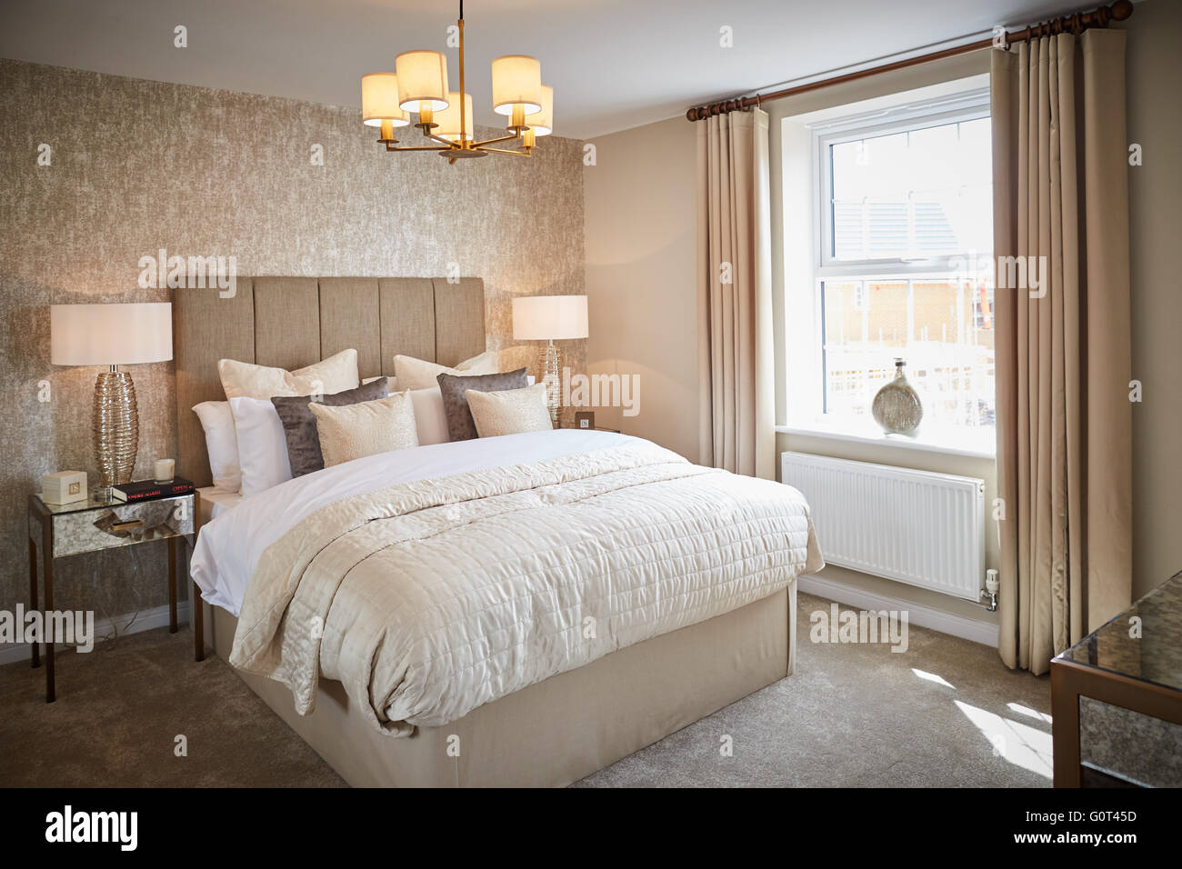 show home interior   main bedroom adult cream magnolia calm  space Suburban suburbia  suburbs town village local - Stock Image