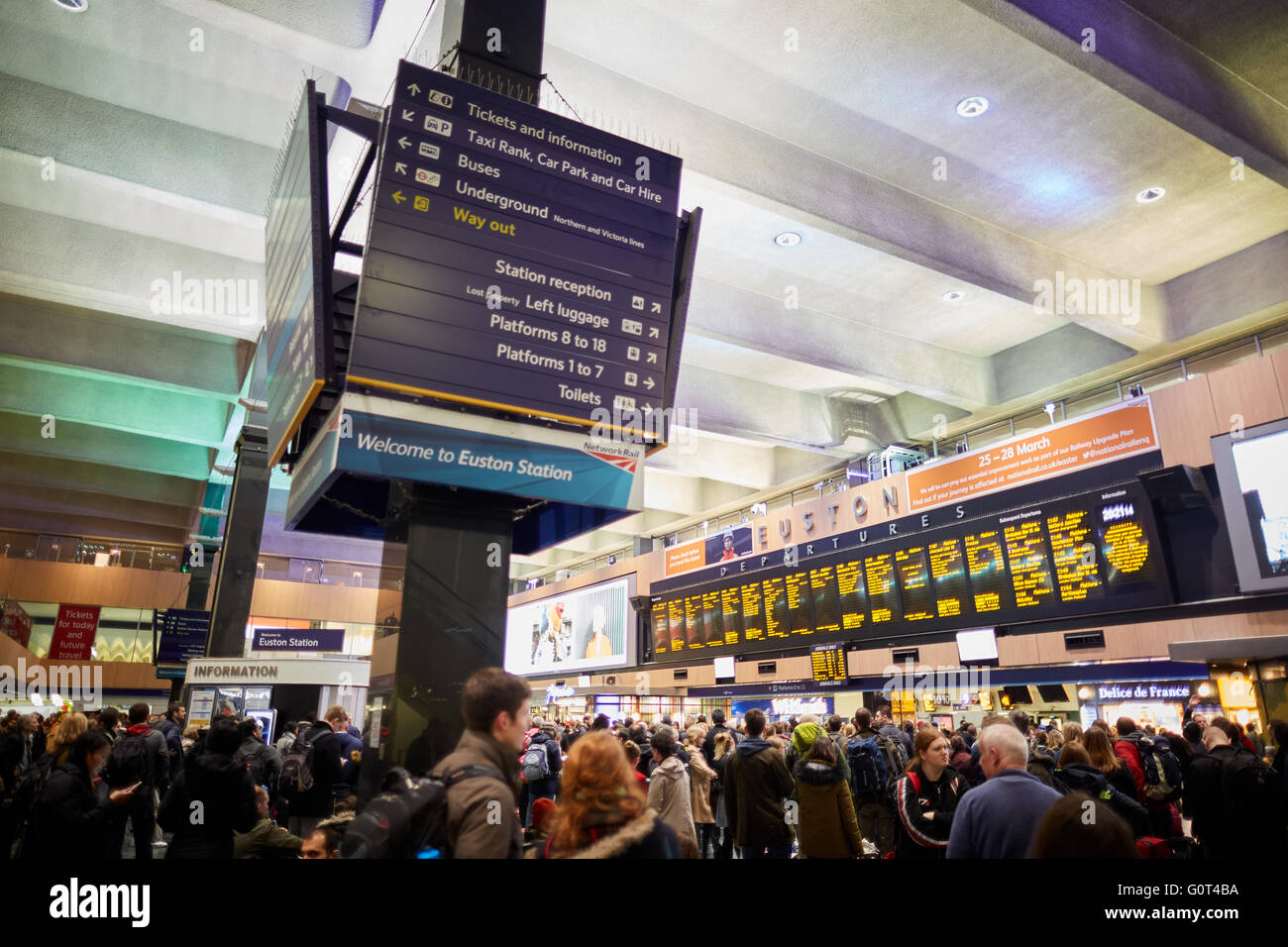 london Euston railway station concourse destination boards waiting area rush crush information point west coast - Stock Image