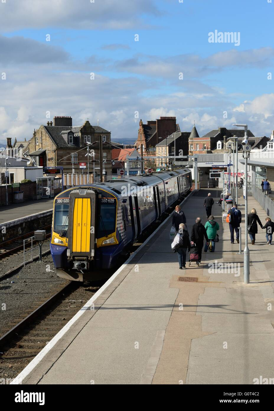 A Scotrail commuter train waiting at the platform in the seaside town of Largs, in Scotland, UK - Stock Image