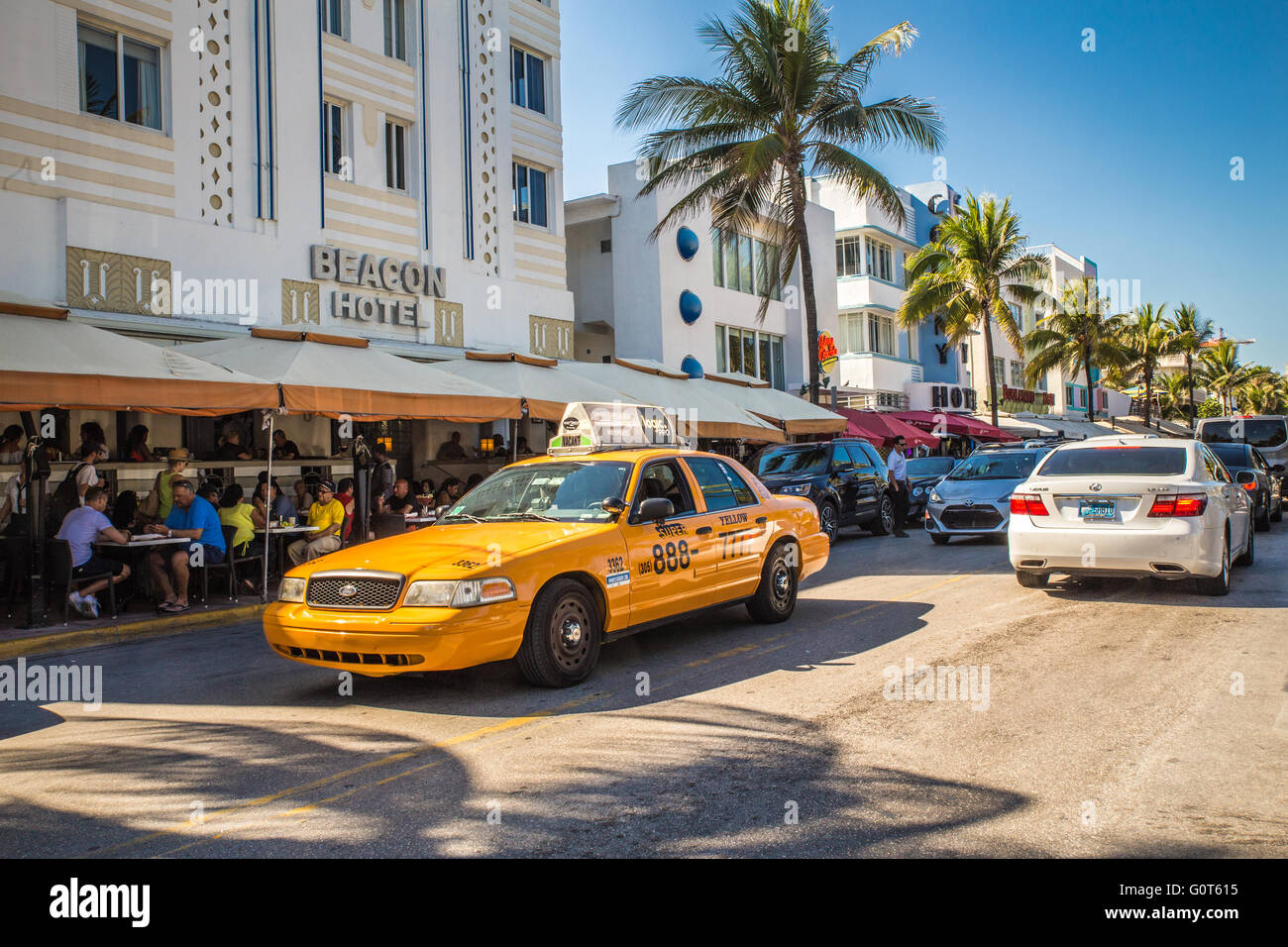 Street scene from South Beach Miami with cars and taxi - Stock Image