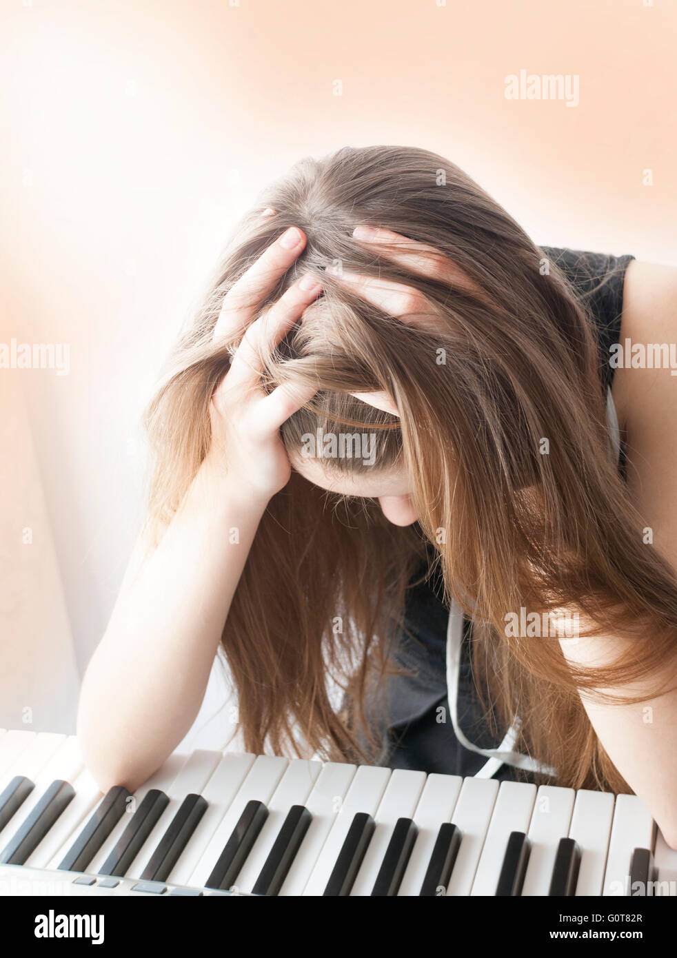 Portrait of a stressed  teenage girl - Stock Image