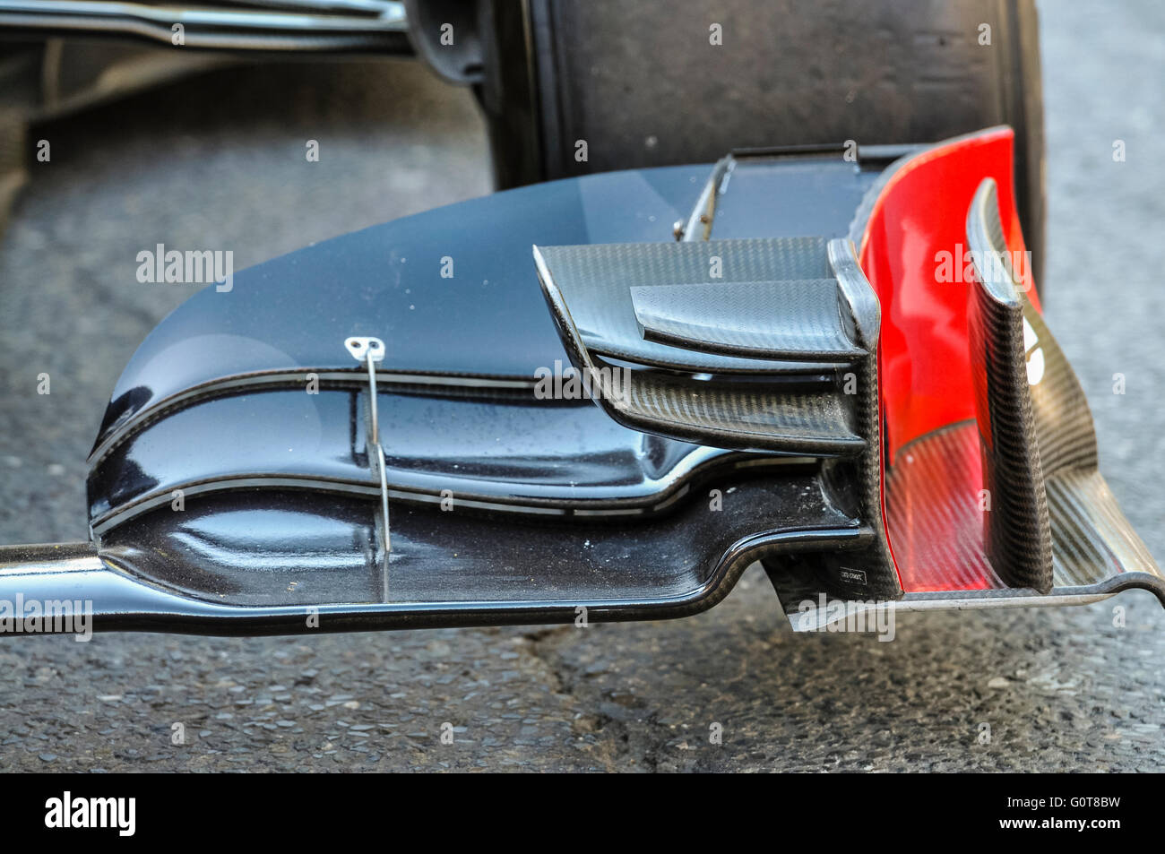 Aerodynamic carbon fibre spoilers on the front nose of a Formula 1 racing car. - Stock Image