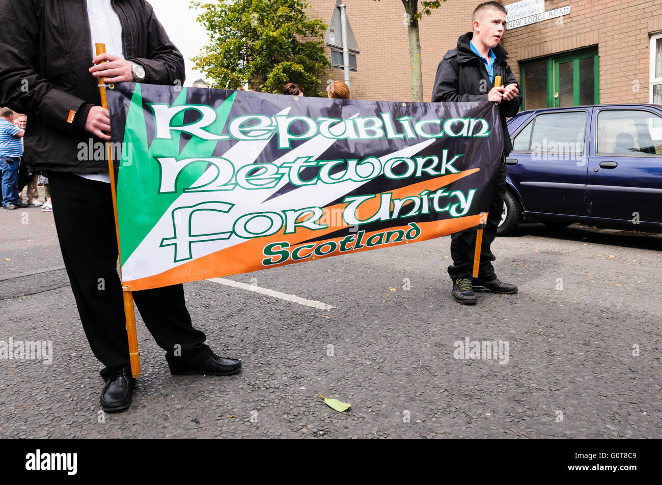 RNU Scotland members carry a banner during a remembrance march - Stock Image