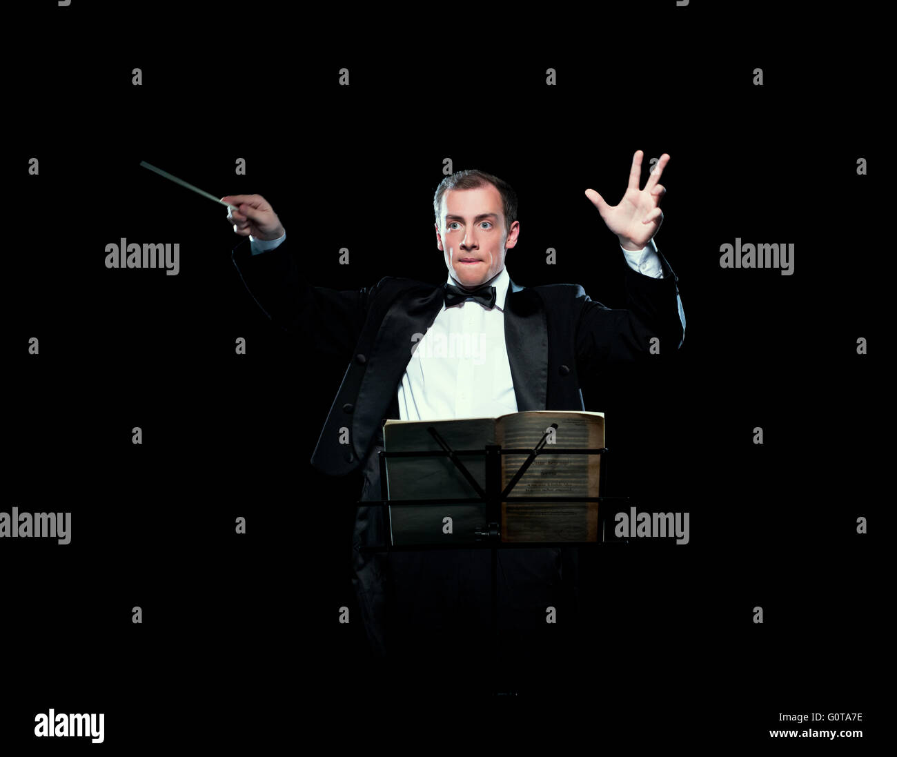 Shot of music director conducting with inspiration - Stock Image