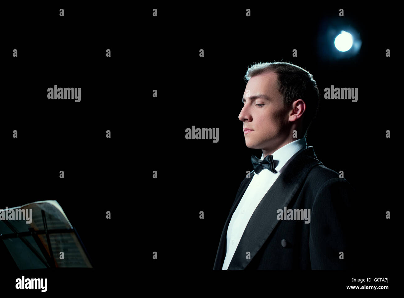 Image of music conductor focused before the show - Stock Image