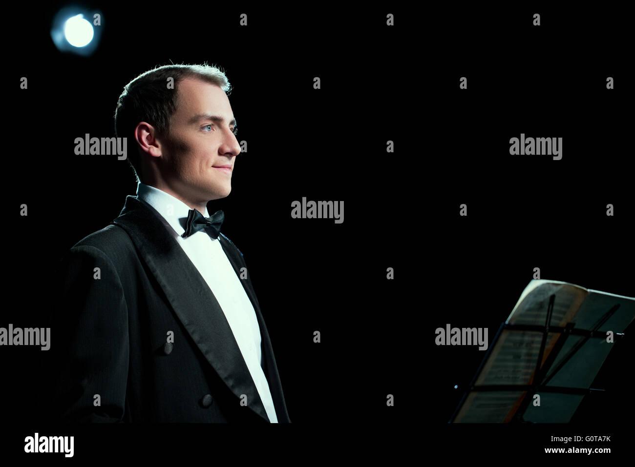 Studio photo of music conductor smiles public - Stock Image
