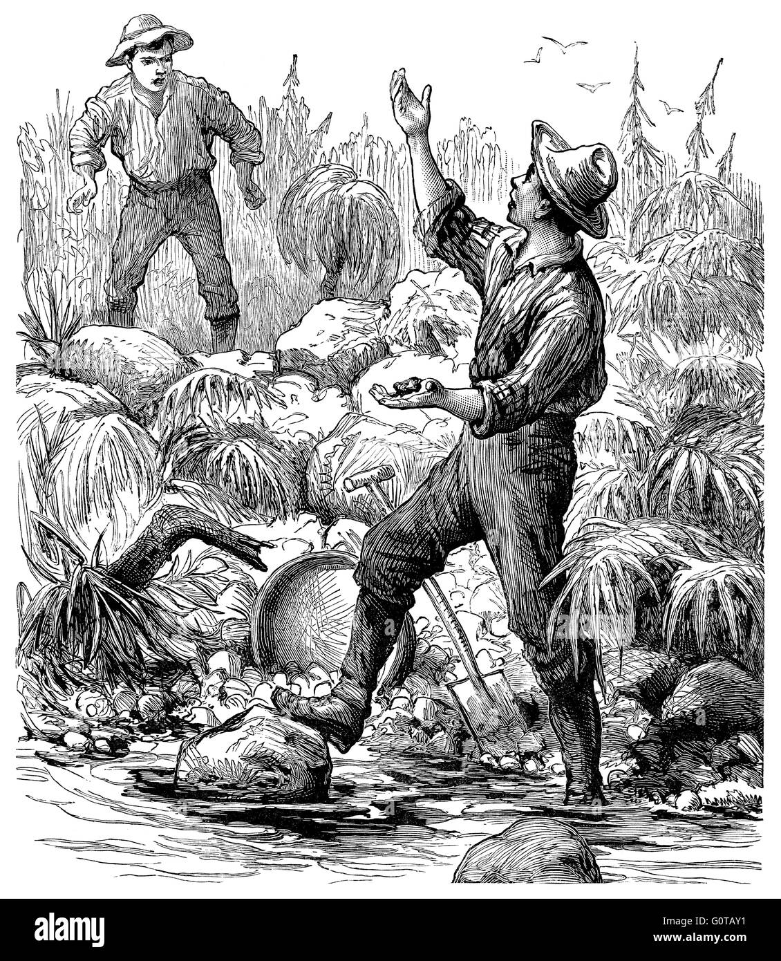 Black and white engraving of Victorian or Edwardian gold prospectors by a river. - Stock Image