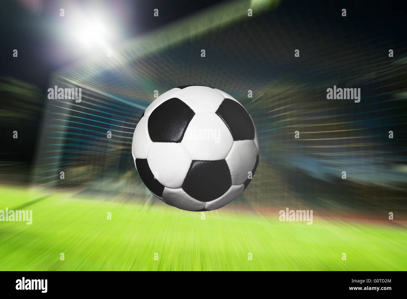 Football flying into goal - Stock Image