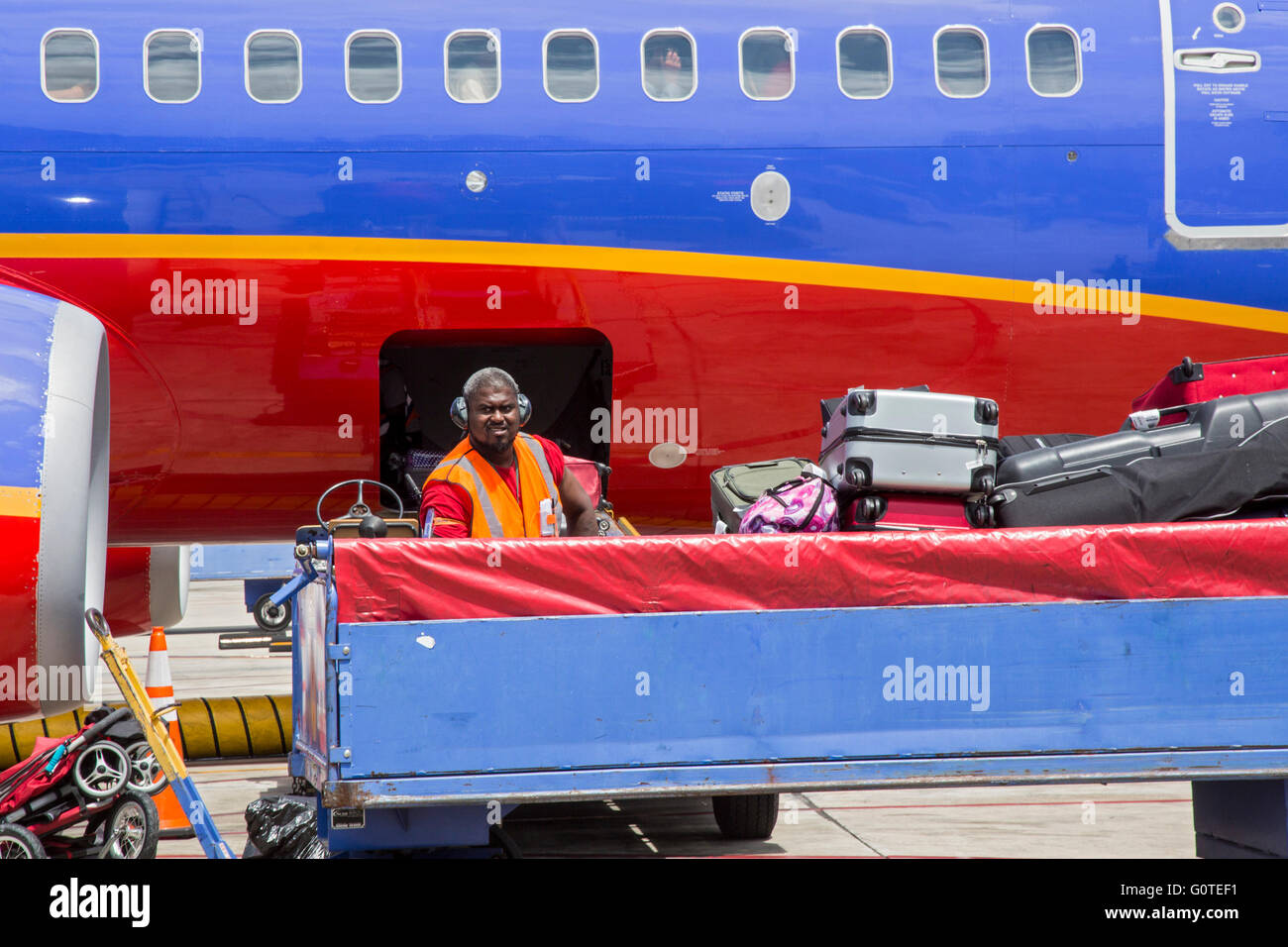 Fort Lauderdale, Florida - A Southwest Airlines baggage handler loads a plane at Fort Lauderdale-Hollywood International Stock Photo