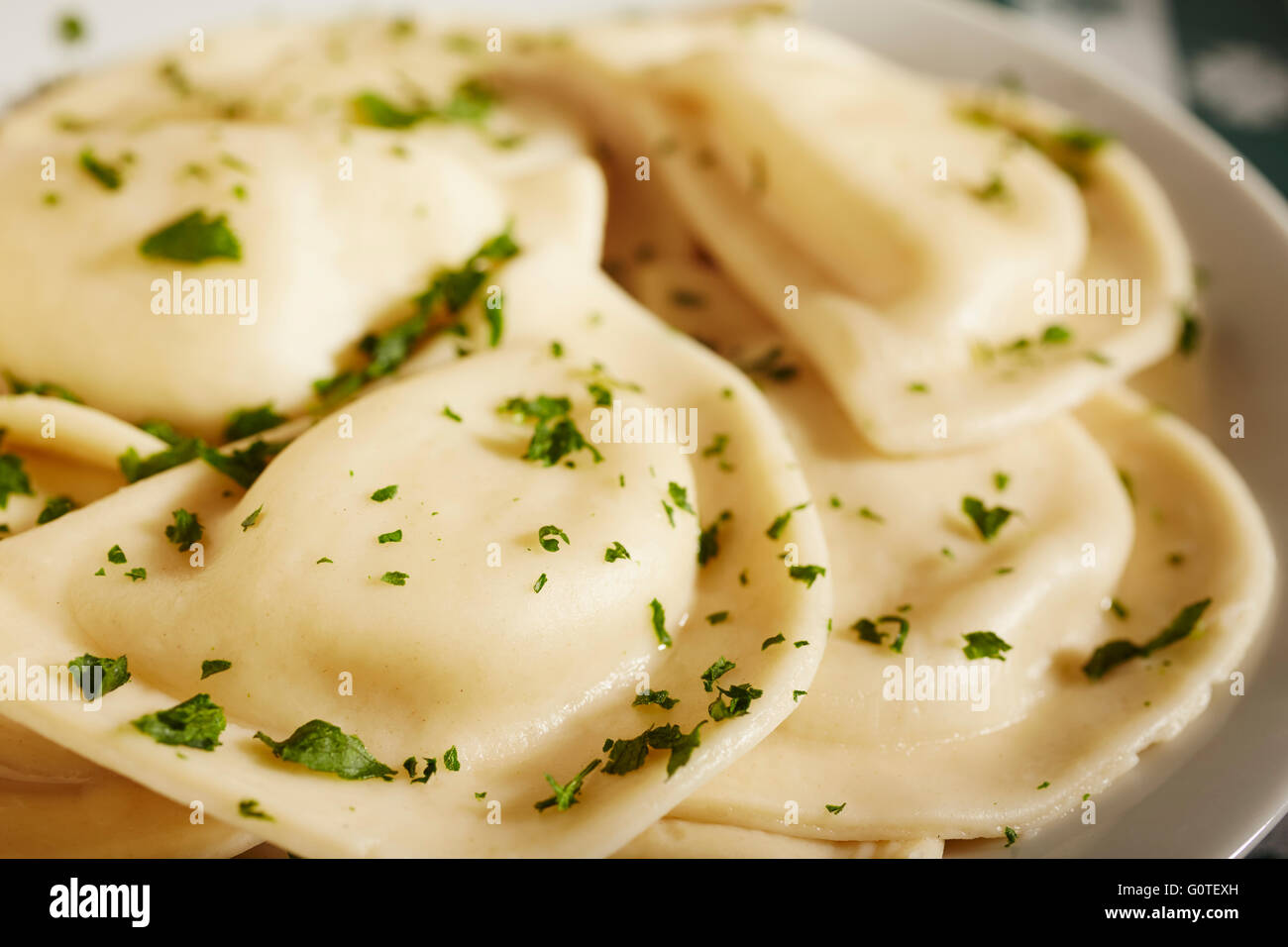A plate of pierogies, the Polish filled pasta dumplings - Stock Image