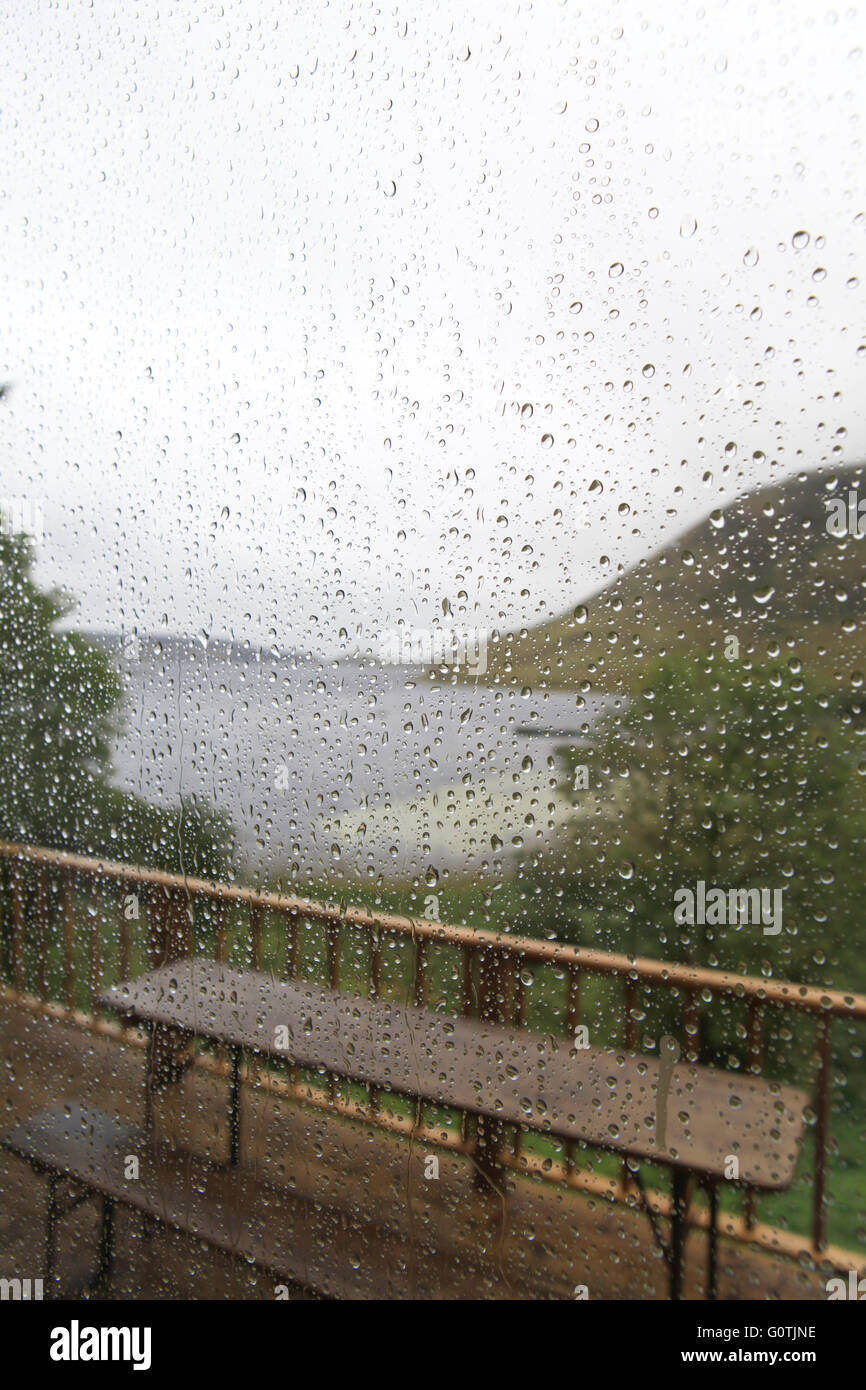 Blurred view of a Lough Talt seen through a window with sharp drops on a rainy day in Co. Sligo, Ireland - Stock Image