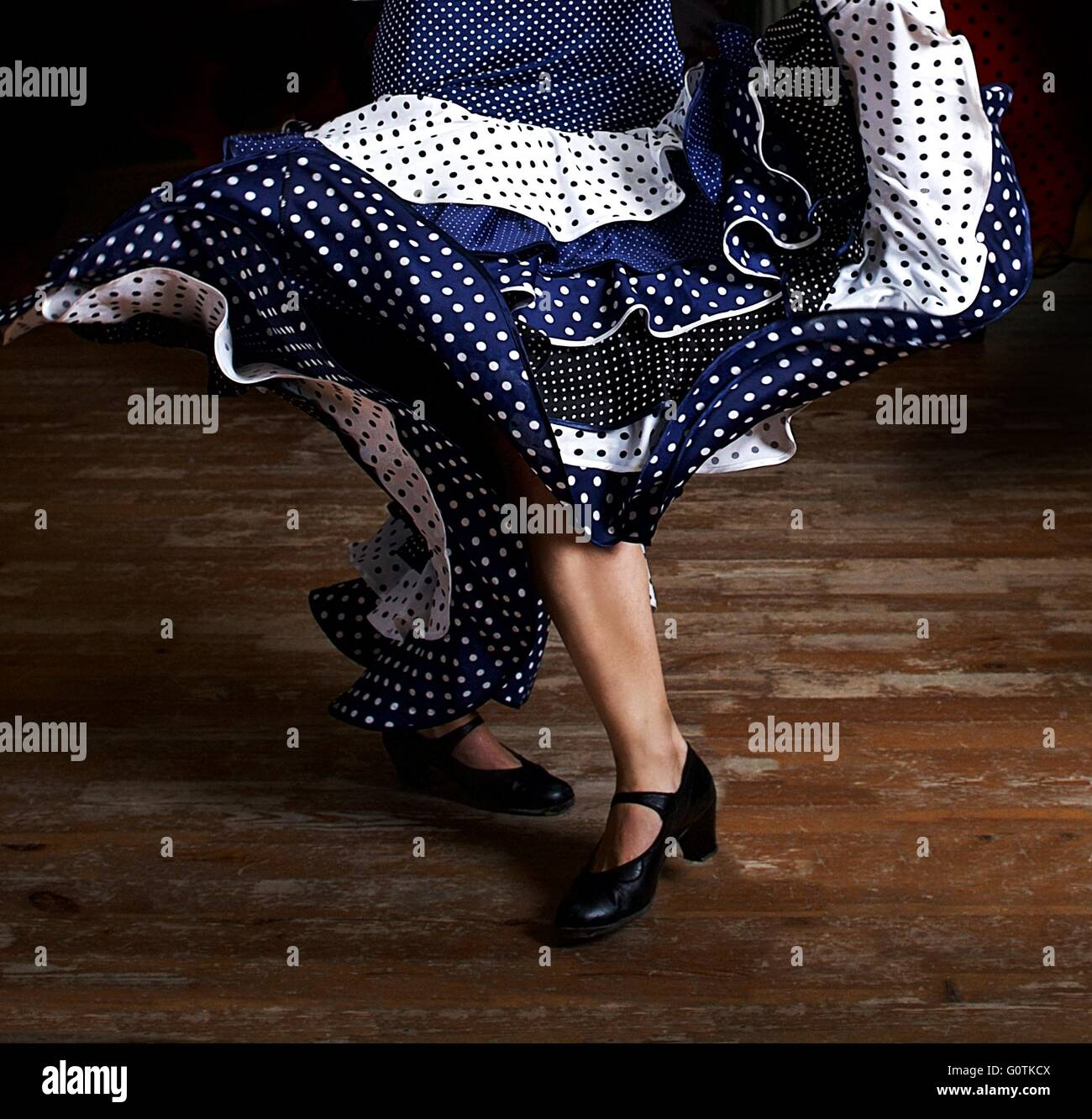 Legs of a woman flamenco dancing in traditional clothing - Stock Image