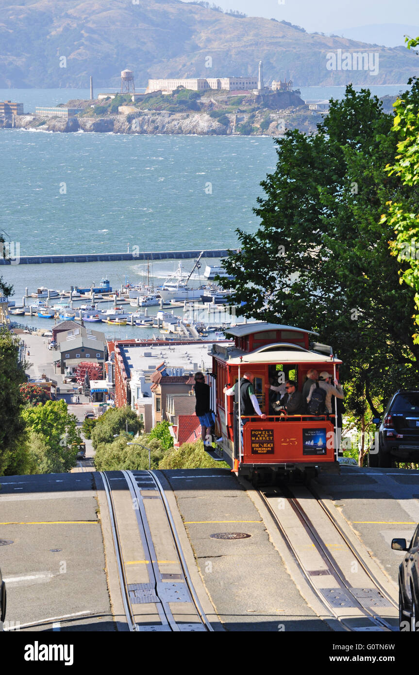 San Francisco, United States of America, Usa: a cable car on rails in Hyde Street with Alcatraz island on the background - Stock Image