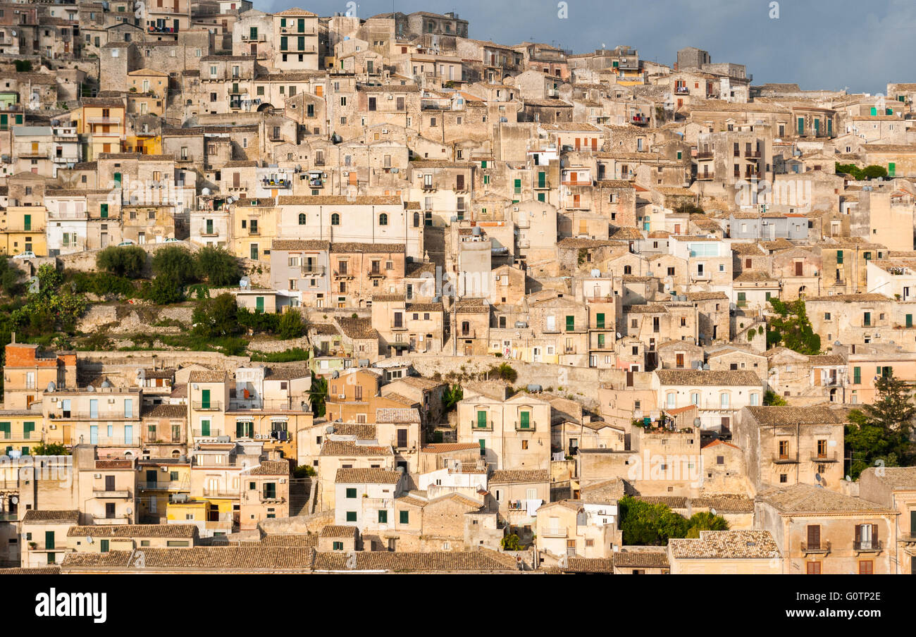 Houses packed in the old town of Modica, in Sicily - Stock Image